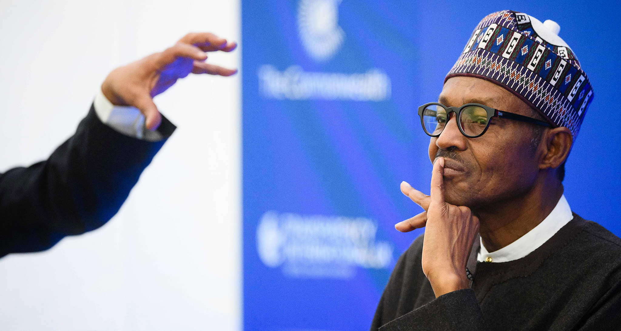 Nigerian President Muhammadu Buhari list...Nigerian President Muhammadu Buhari listens at the start of a conference to tackle corruption at the Commonwealth Secretariat in London on May 11, 2016. / AFP PHOTO / LEON NEALLEON NEAL/AFP/Getty Images