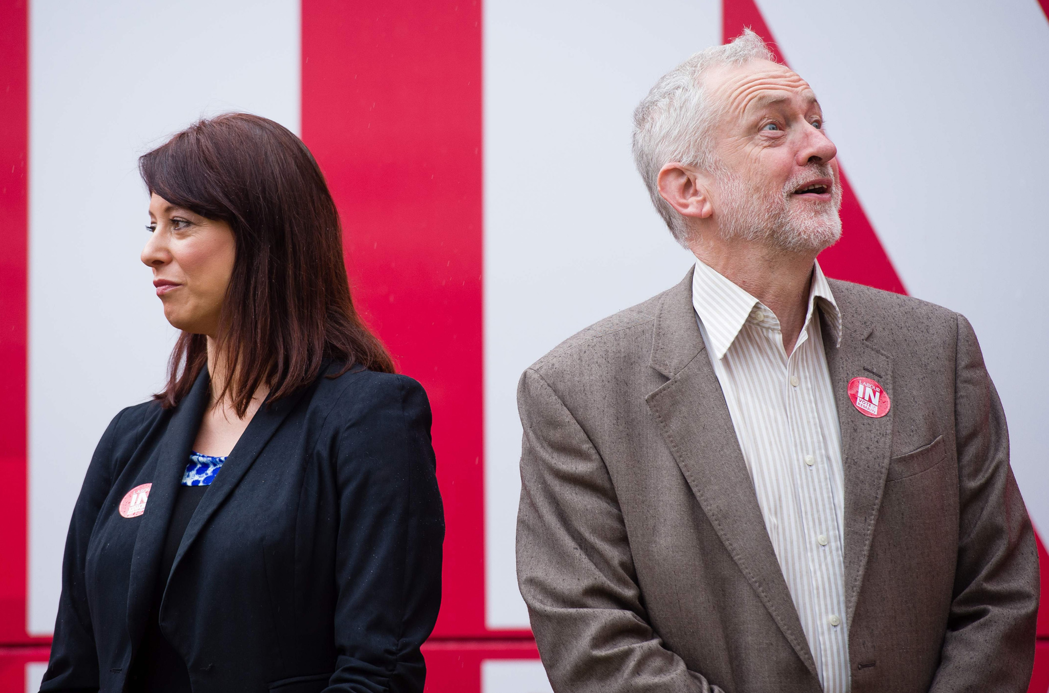 "Britain's opposition Labour Party leader Jeremy Corbyn and shadow Minister for Young People, Gloria De Piero (L) stand in front of the ""Labour In For Britain"" campaign bus at a launch in central London, on May 10, 2016. The referendum campaign was picking up pace again after regional and local elections last Thursday which saw Labour's Sadiq Khan elected as London's new mayor, and pro-independence nationalists returned to power in Scotland, albeit without a majority. Main opposition Labour leader Jeremy Corbyn was now being urged to get more involved in the EU referendum campaign.  / AFP PHOTO / LEON NEALLEON NEAL/AFP/Getty Images"