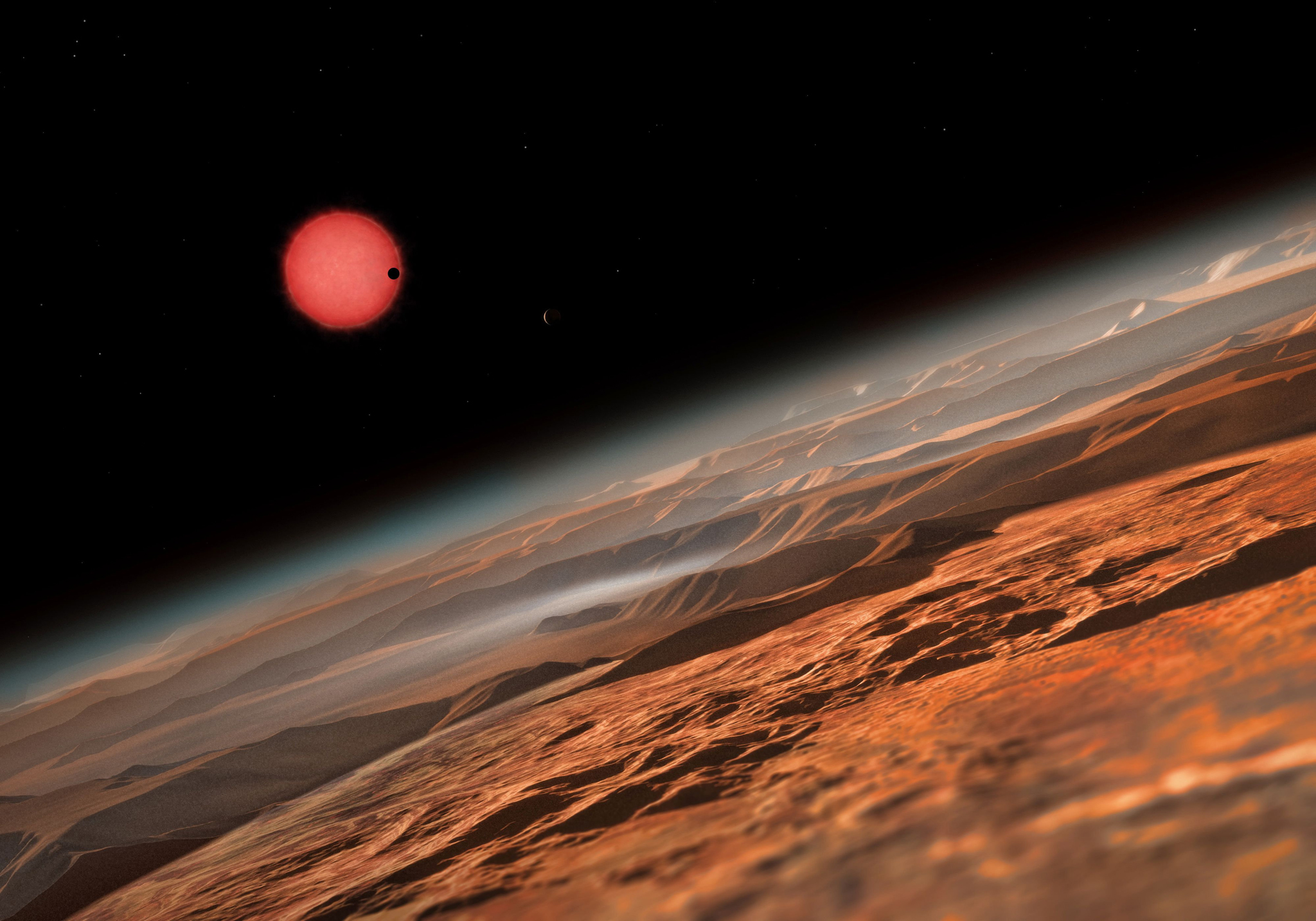 "An artists impression released by the the European Southern Observatory (ESO) on May 2, 2016 shows an imagined view from close to one of the three planets orbiting an ultracool dwarf star just 40 light-years from Earth that were discovered using the TRAPPIST (""TRAnsiting Planets and PlanetesImals Small Telescope"") telescope at ESOs La Silla Observatory in Chile. These worlds have sizes and temperatures similar to those of Venus and Earth and are the best targets found so far for the search for life outside the Solar System. They are the first planets ever discovered around such a tiny and dim star. In this view one of the inner planets is seen in transit across the disc of its tiny and dim parent star."