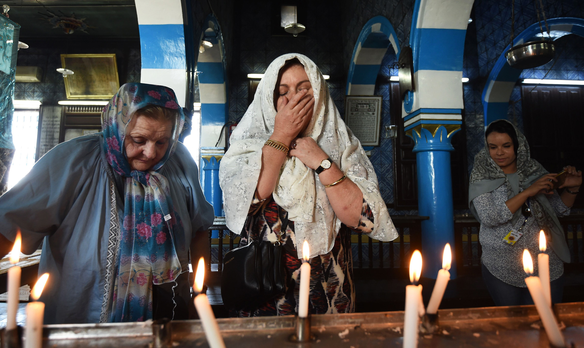 French Tunisian Jewish women pray at the Ghriba synagogue in the Tunisian resort island of Djerba during the annual Jewish pilgrimage on May 25, 2016