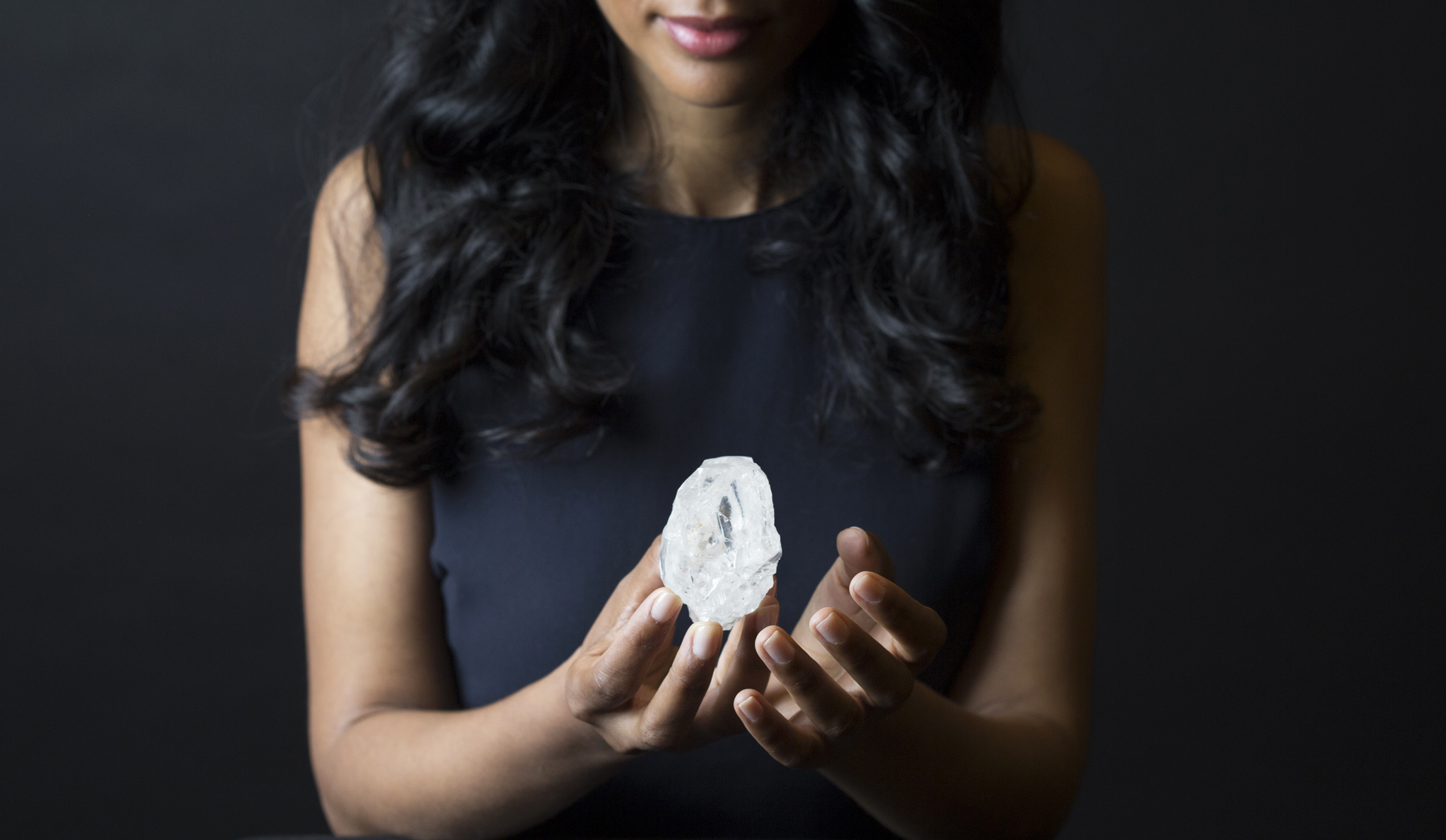 A Sotheby's  employee  holds Lesedi La Rona Diamond on May Tuesday  3, 2016 in New York City. The diamond the size of a tennis ball that is the largest discovered in more than a century could sell at auction for more than $70 million. Sotheby's says it will offer the Lesedi la Rona diamond in London on June 29