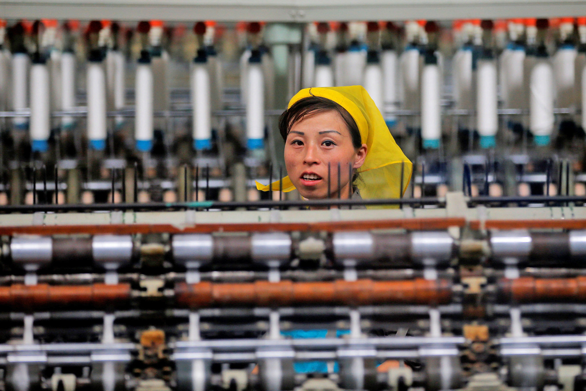 A woman works at the Kim Jong Suk Pyongyang textile mill during a government organised visit for foreign reporters in Pyongyang, North Korea May 9, 2016.