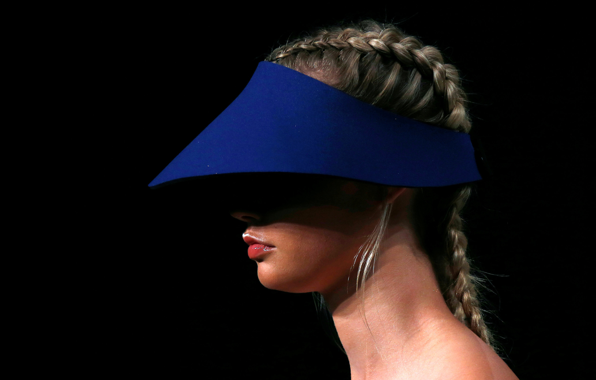 A model wears a hat as she presents a creation from the fashion label Bondi Bather during Australian Fashion week in Sydney, Australia, May 19, 2016. REUTERS/David Gray