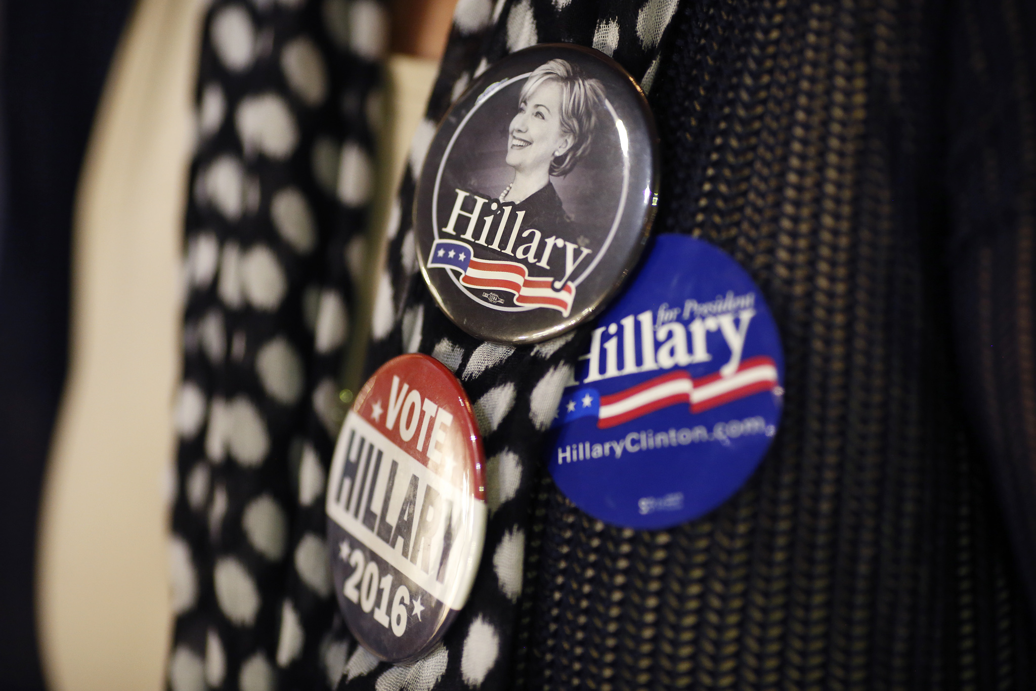 "Presidential Candidate Hillary Clinton Holds Kentucky Campaign Rally...An attendee wears campaign buttons before the start of an event for Hillary Clinton, former Secretary of State and 2016 Democratic presidential candidate, not pictured, in Louisville, Kentucky, U.S., on Tuesday, May 10, 2016. Clinton said she sees ""a great role"" for Bernie Sanders and his supporters in a ""unified party,"" even as she said she welcomed Republicans who are not supporting presumptive nominee Donald Trump. Photographer: Luke Sharrett/Bloomberg"