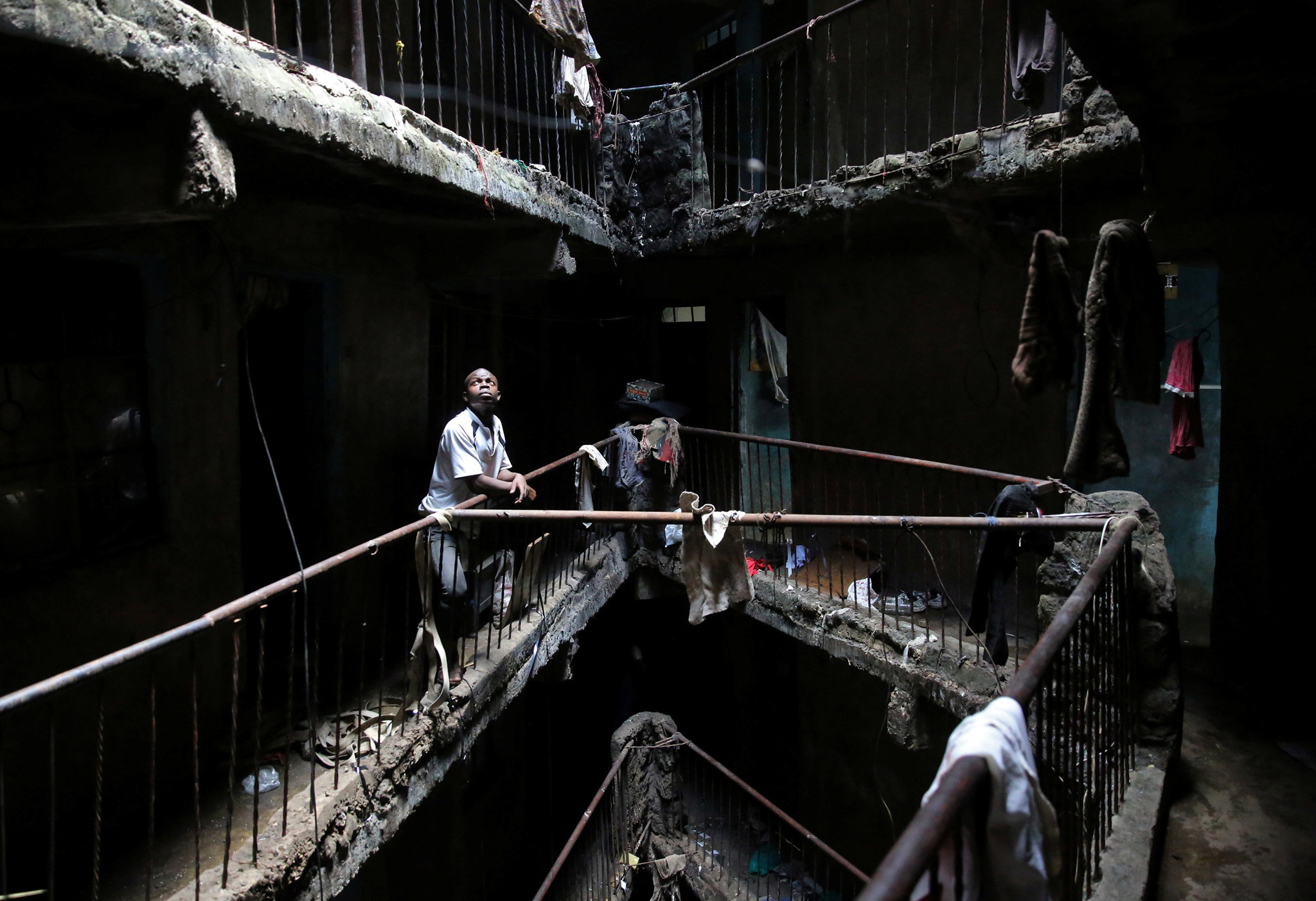 "A man stands in a building earmarked for demolition in the Mathare neighbourhood of Nairobi, Kenya, May 17, 2016. Kenya's authorities tore down a badly built residential block in the poor Nairobi district on Tuesday, one of more than 250 shoddy buildings that could now face demolition after a six-story structure collapsed this month killing 51 people. REUTERS/Goran Tomasevic SEARCH ""MATHARE DEMOLITION"" FOR THIS STORY. SEARCH ""THE WIDER IMAGE"" FOR ALL STORIES   TPX IMAGES OF THE DAY"
