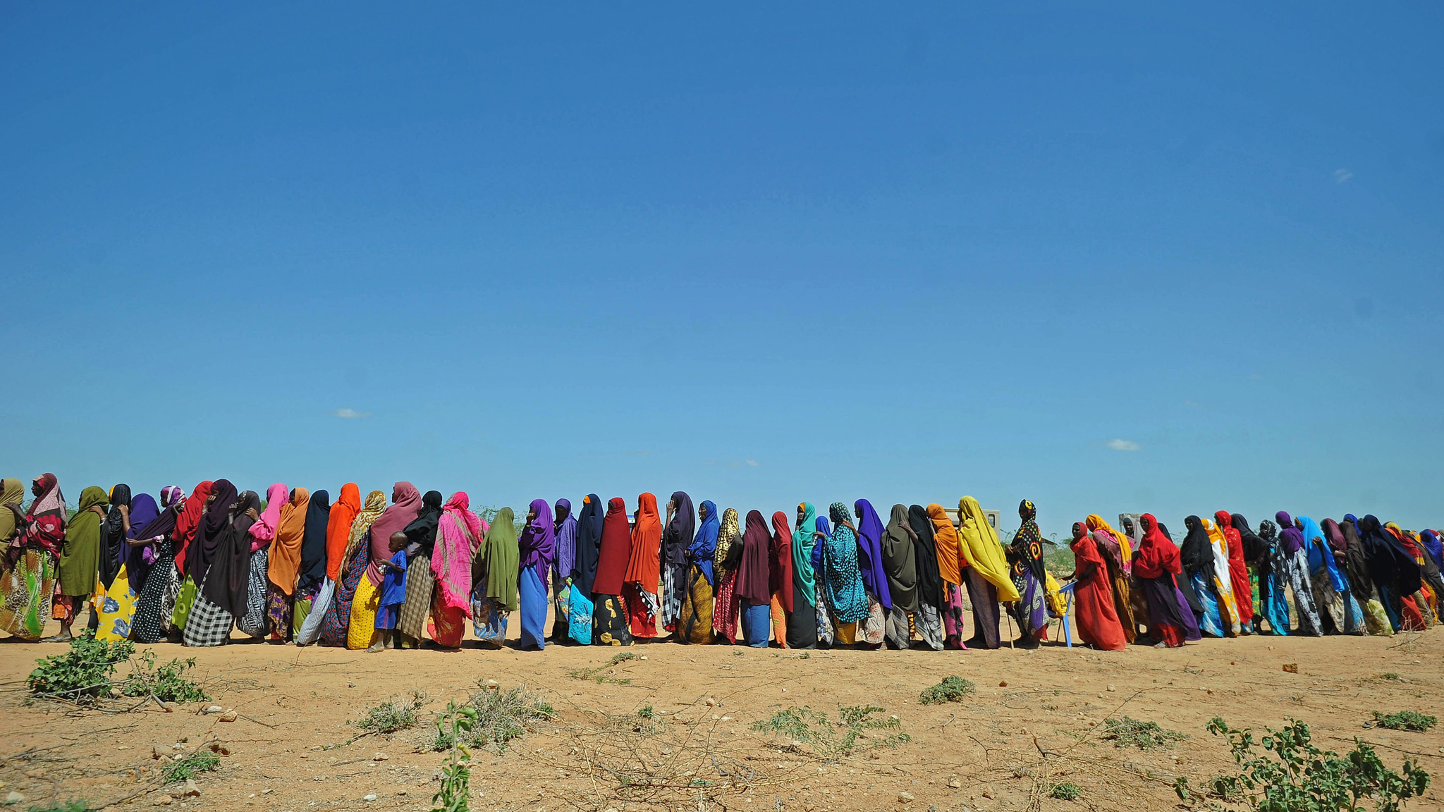 Displaced Somalis queue for aid in Beledweyne, north of Mogadishu on May 26, 2016. Hundreds of families have been forced out of their homes following flash floods in Beledweyne after torrential rains pounded the area in the last few days.The heavy rains led to the bursting of River Shabelle which caused massive floods in residential areas along the river.  / AFP PHOTO / MOHAMED ABDIWAHABMOHAMED ABDIWAHAB/AFP/Getty Images