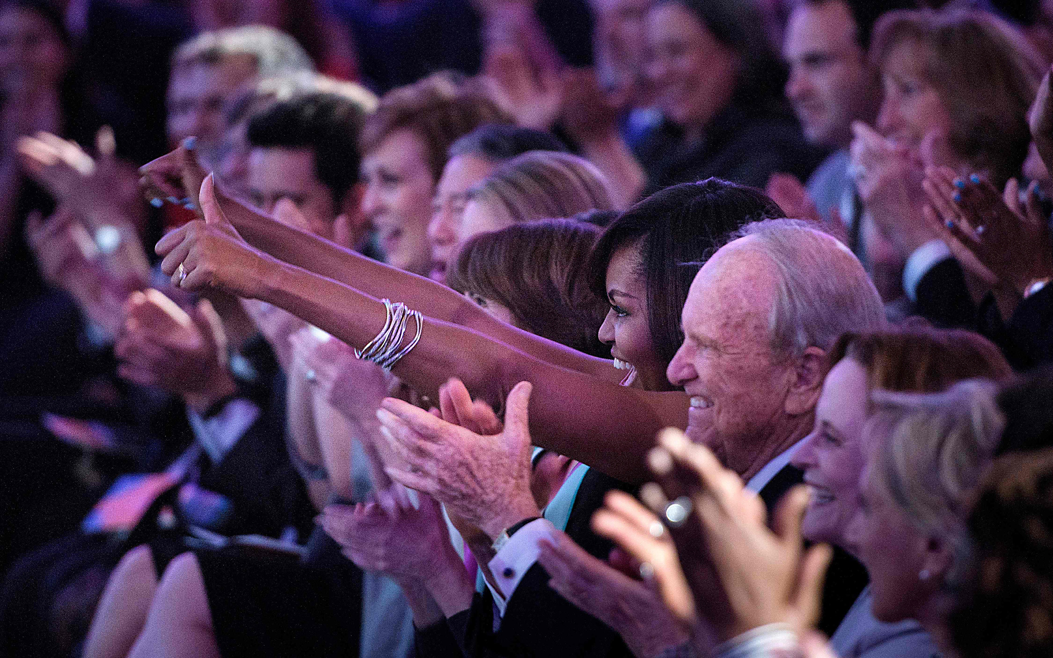 TOPSHOT - US First Lady Michelle Obama cheers during the White House Turnaround Arts Talent Show at the White House May 25, 2016 in Washington, DC.  Students from throughout the US performed at the presidential mansion showcasing the power of arts education.  / AFP PHOTO / Brendan SmialowskiBRENDAN SMIALOWSKI/AFP/Getty Images