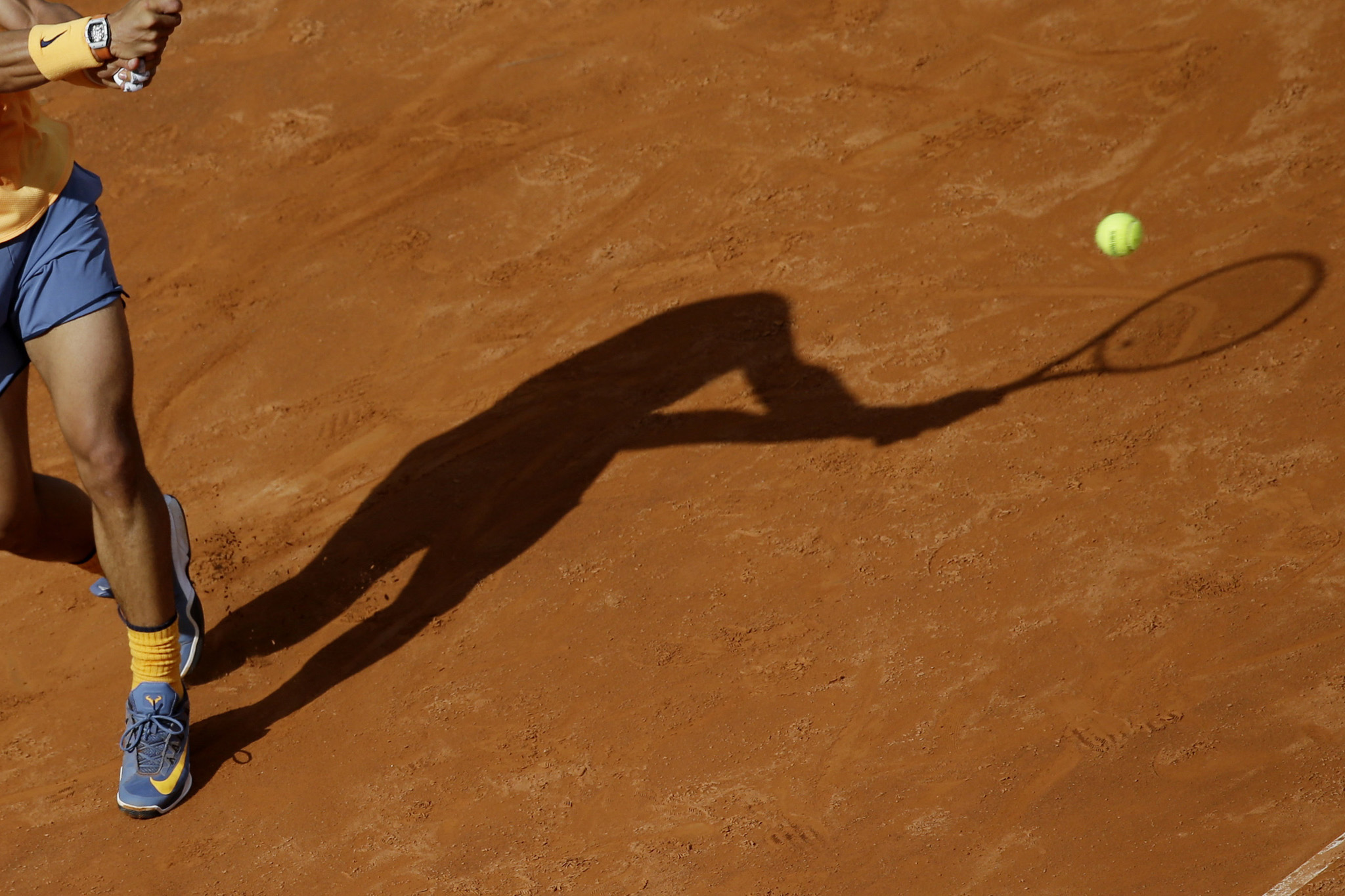 Rafael Nadal of Spain returns the ball to Nick Kyrgios of Australia during their match at the Italian Open tennis tournament, in Rome, Thursday, May 12, 2016. (AP Photo/Andrew Medichini)