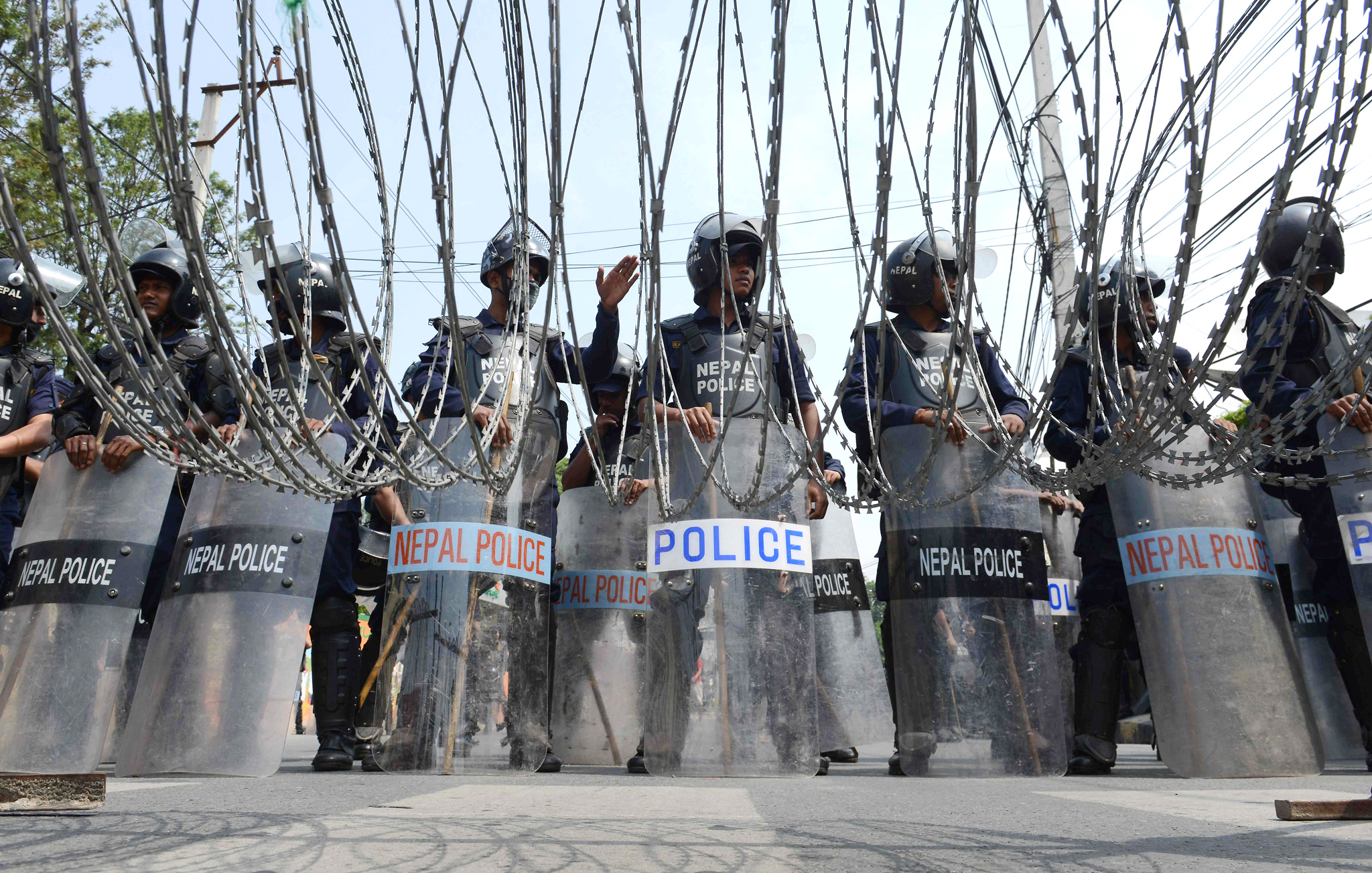 Nepalese riot police stand guard as activists from the Federal Alliance (members of the Madhesi and ethnic communities) demonstrate against the government in Kathmandu on May 17, 2016.   Hundreds of members of Nepal's ethnic minorities blocked roads in renewed protests calling for changes to the Himalayan nation's controversial new constitution. / AFP PHOTO / PRAKASH MATHEMAPRAKASH MATHEMA/AFP/Getty Images