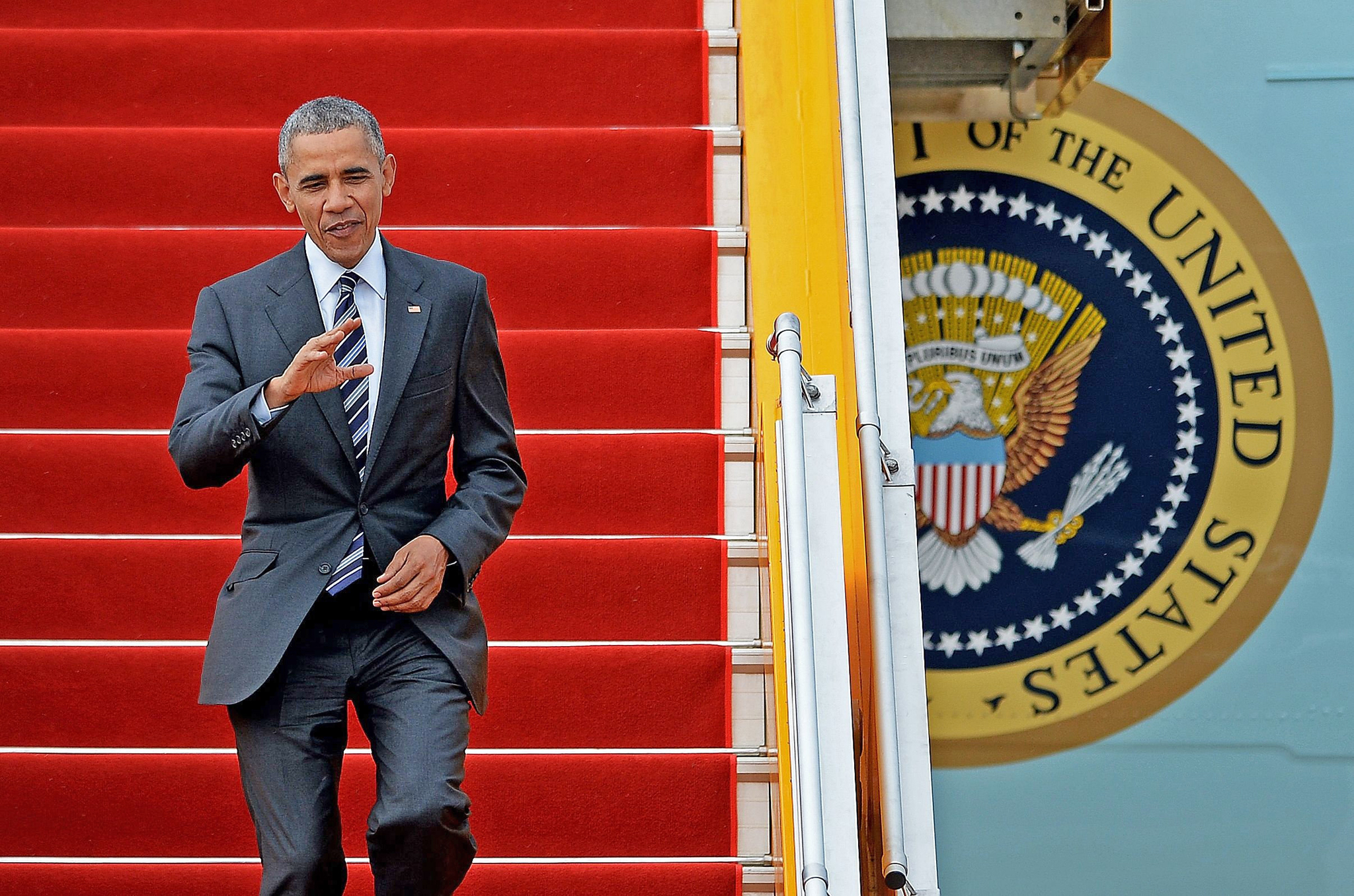 US President Barack Obama waves as he disembarks from Air Force One at the Tan Son Nhat airport in Ho Chi Minh City on May 24, 2016. Obama told communist Vietnam that basic human rights would not jeopardise its stability, in an impassioned appeal for the one-party state to abandon authoritarianism. / AFP PHOTO / CHRISTOPHE ARCHAMBAULTCHRISTOPHE ARCHAMBAULT/AFP/Getty Images