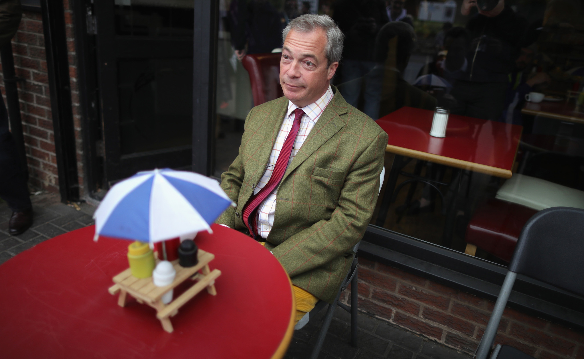 Leader of the United Kingdom Independence Party (UKIP), Nigel Farage sits outside a cafe waiting for his coffee during campaigning for votes to leave the European Union on May 25, 2016 near Sheffield, England