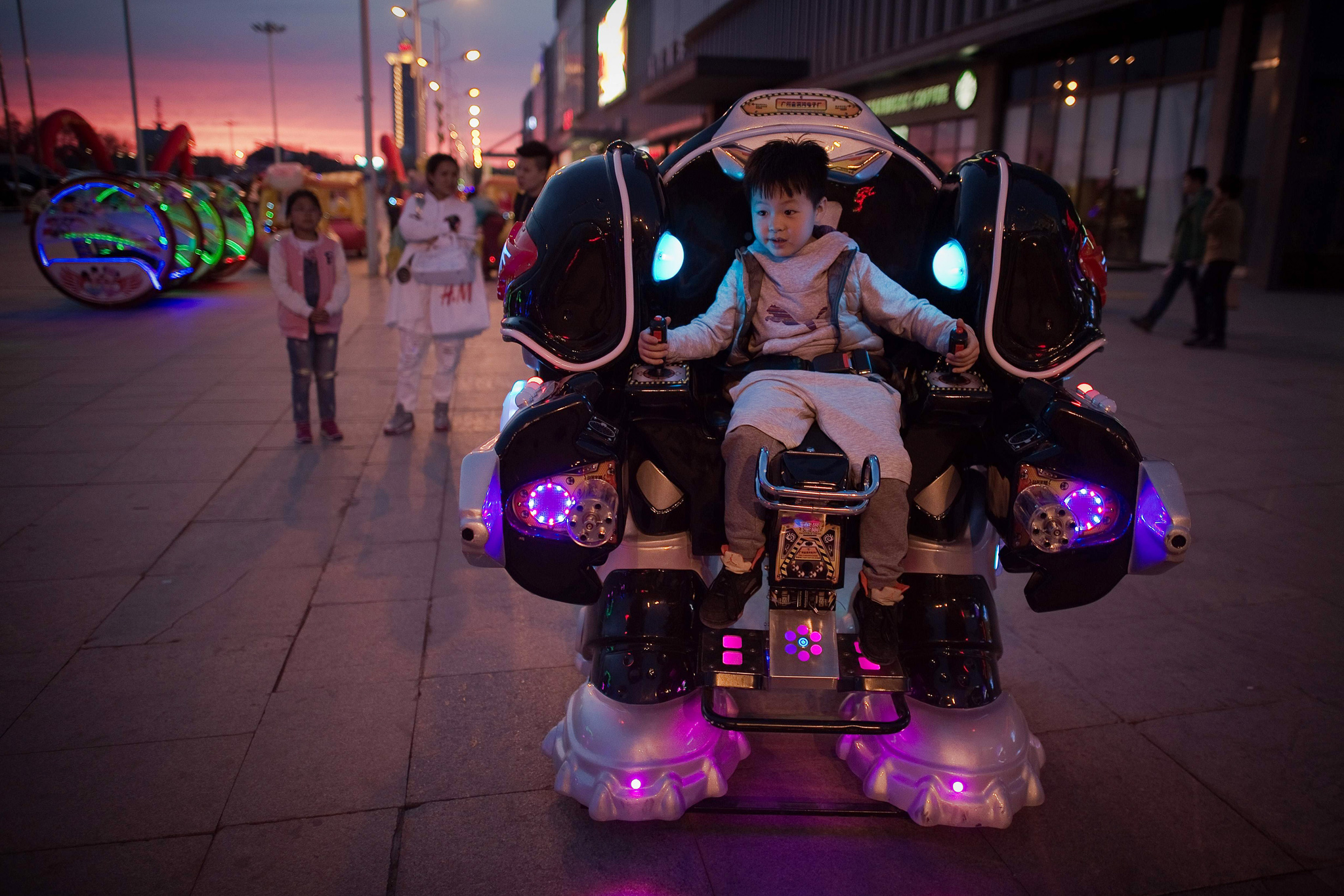 A boy rides a robot style vehicle outsid...A boy rides a robot style vehicle outside a shopping mall in Daqing, Heilongjiang province on May 2, 2016. / AFP PHOTO / NICOLAS ASFOURINICOLAS ASFOURI/AFP/Getty Images