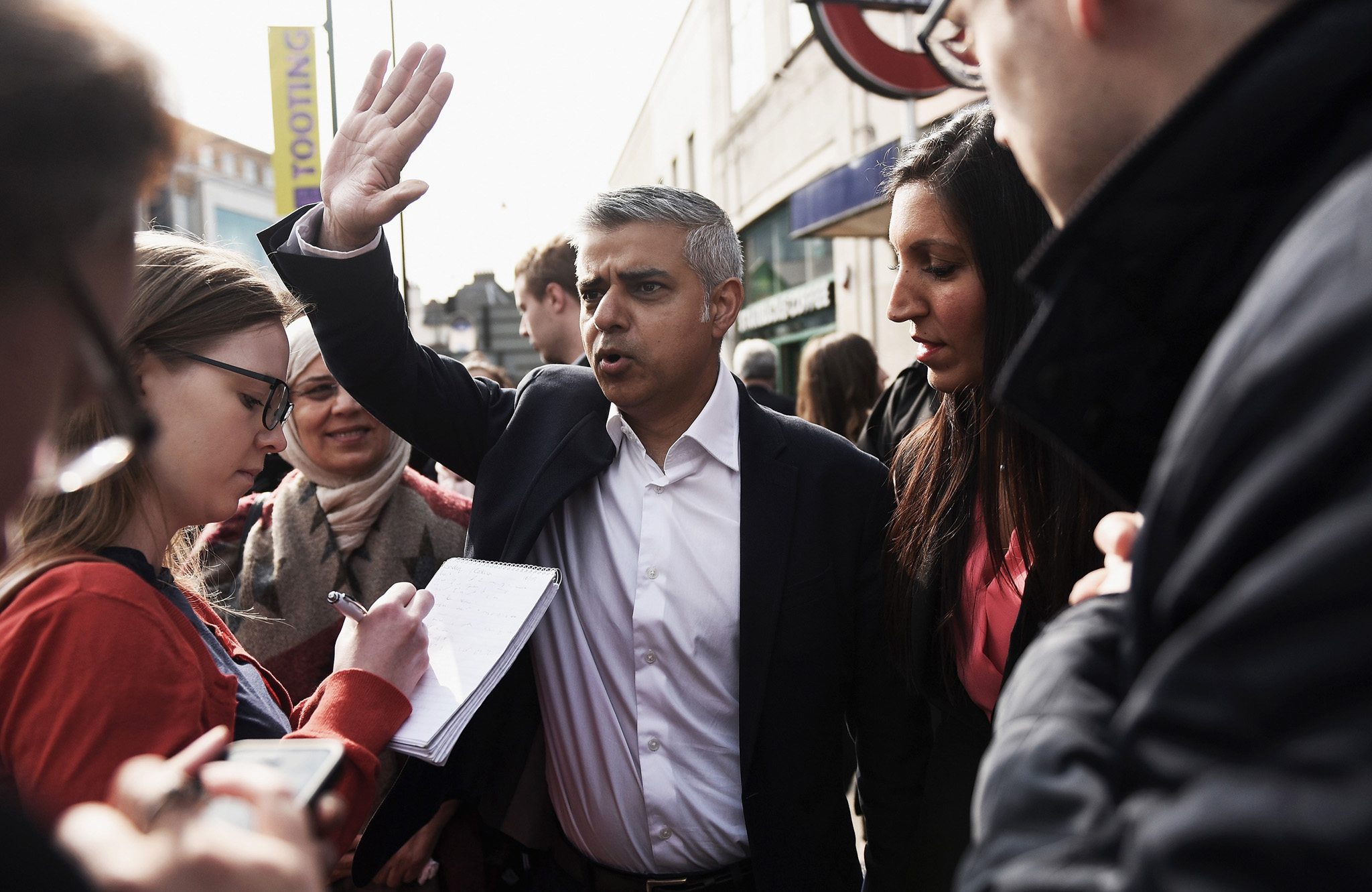 LONDON, ENGLAND - MAY 16:  Sadiq Khan, the new Mayor of London waves to a member of the public as he campaigns outside Tooting Broadway Underground station with Labour Party candidate for the local by-election Rosena Allin-Khan on May 16, 2016 in London, England. Rosena Allin-Khan is a junior accident and emergency doctor and mother of two who grew up in the constituency where Sadiq Khan's election to London Mayor has prompted a by-election.  (Photo by Mary Turner/Getty Images)