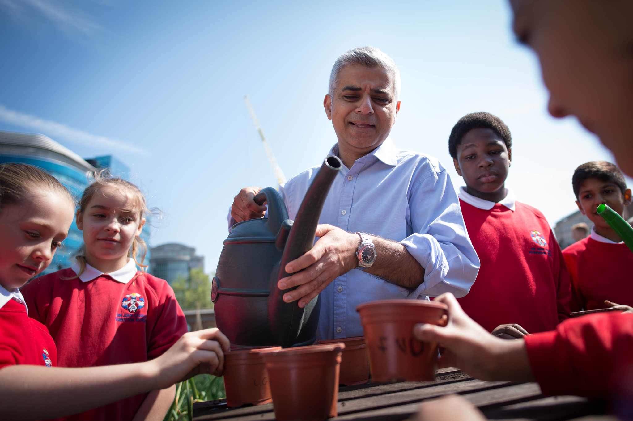 Mayoral visit to Sir John Cass's Foundation Primary School...Newly elected Mayor of London, Sadiq Khan, meets pupils at Sir John Cass's Foundation Primary School in the City of London, where he helped the children plant seeds and flowers on their green roof garden after seeing an air pollution monitoring station in the playground. PRESS ASSOCIATION Photo. Picture date: Friday May 13, 2016. Mr Khan has promised to clean up London's toxic air - as he revealed he has only recently started suffering from asthma. See PA story POLITICS Khan. Photo credit should read: Stefan Rousseau/PA Wire