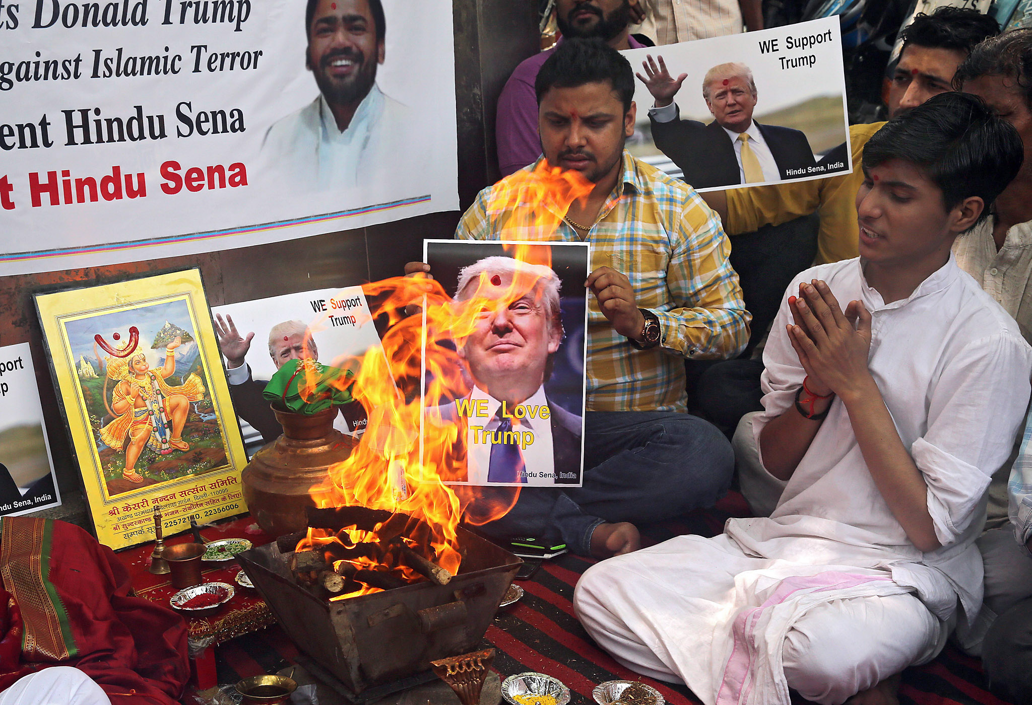 Right-wing organisation Hindu Sena perform Hindu fire rituals in support of Donald Trump in New Delhi...epa05298860 Indian activists from the right-wing organisation Hindu Sena perform Hindu fire rituals in support of US Republicans presidential candidate Donald Trump in New Delhi, India, 11 May 2016. Right-wing organisation Hindu Sena activists prayed to the Hindu gods and performed rituals to ensure the victory of Donald Trump in US Presidential elections and urged the Indian origin people living in USA to vote and support him.  EPA/RAJAT GUPTA