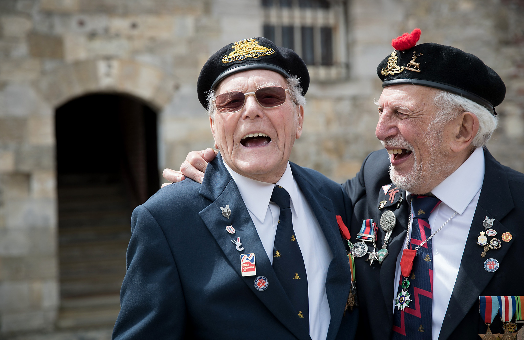 PORTSMOUTH, ENGLAND - MAY 20:  World War II veterans Denys Hunter, 92 (L) and Joe Cattini, 93, (R) laugh as they are photographed after being award France's highest honour, The Legion D'Honneur, in recognition of their part in the liberation of France at the D-Day Museum on May 20, 2016 in Portsmouth, England. The pals, who were both in the 86th Field Regiment of the Hertfordshire Yeomanry Royal Artillery and landed on Gold Beach on D-Day, were reunited by chance for the first time in 70 years in 2014 when they were both heading off to Normandy for the 70th anniversary of the allied landings. The National Order of the Legion of Honour which was established by Napoleon in 1802, is France's highest decoration and is being awarded to surviving British servicemen as a recognition for their efforts on D-Day in June 1944 that helped lead to the eventual defeat of Nazi Germany in WWII.  (Photo by Matt Cardy/Getty Images)