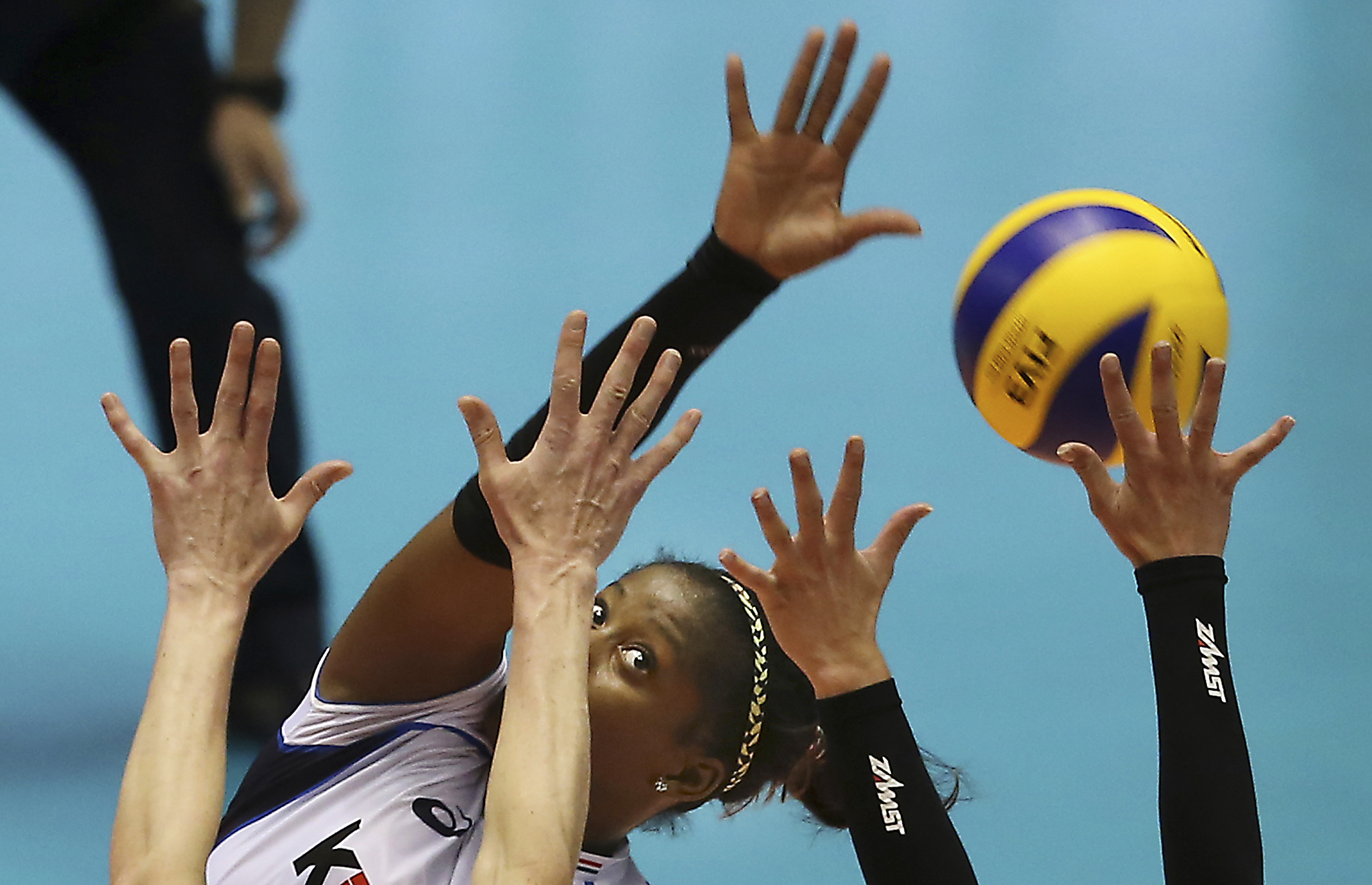 Miriam Fatime Sylla of Italy spikes the ball against Netherland during their Women's Volleyball World Olympic qualification tournament in Tokyo, Japan, Friday, May 20, 2016. (AP Photo/Koji Sasahara)