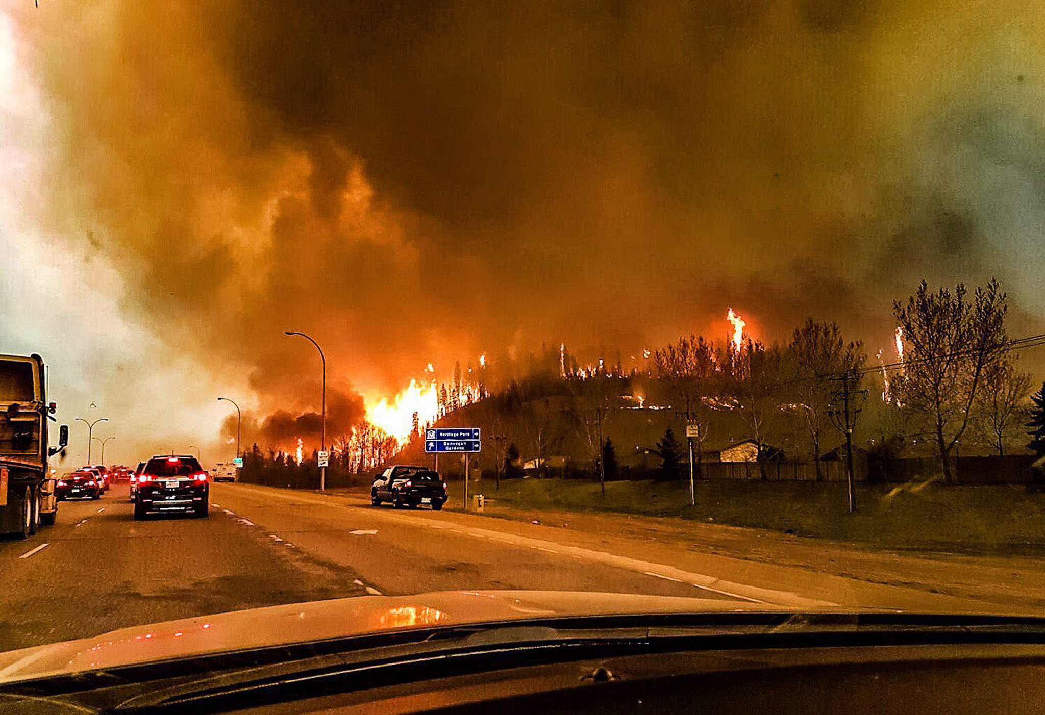 Wildfire in Fort McMurray...epa05290226 A picture provided by Twitter user @jeromegarot on 05 May 2016 shows a wildfire raging through the town of Fort McMurray, Canada, 03 May 2016. Weather conditions were making it more difficult to extinguish a forest fire that has forced the evacuation of some 70,000 people from the northwestern Canadian city of Fort McMurray. Alberta provincial authorities estimated that at least some 1,600 buildings in the city have been consumed by the flames, which have not caused any deaths or injuries so far.  EPA/TWITTER.COM/JEROMEGAROT ATTENTION EDITORS : EPA IS USING AN IMAGE FROM AN ALTERNATIVE SOURCE AND CANNOT PROVIDE CONFIRMATION OF CONTENT, AUTHENTICITY, PLACE, DATE AND SOURCE.  EDITORIAL USE ONLY/NO SALES