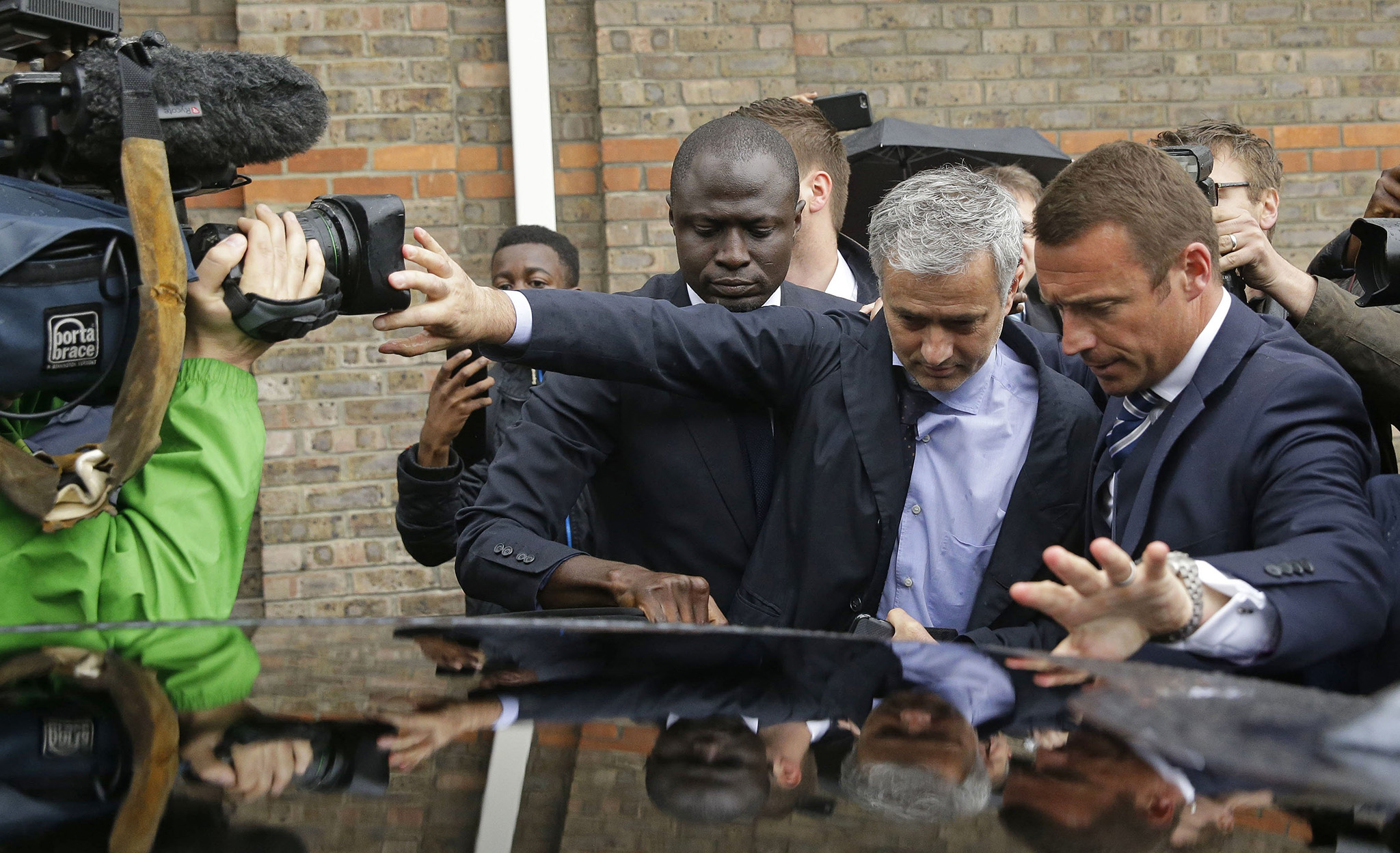 Former manager of Chelsea and current manager of Manchester United Jose Mourinho, centre, tries to get in the back of a car as he leaves after attending an employment tribunal for former Chelsea team doctor Eva Carneiro at the Croydon Employment Tribunal in Croydon, south London
