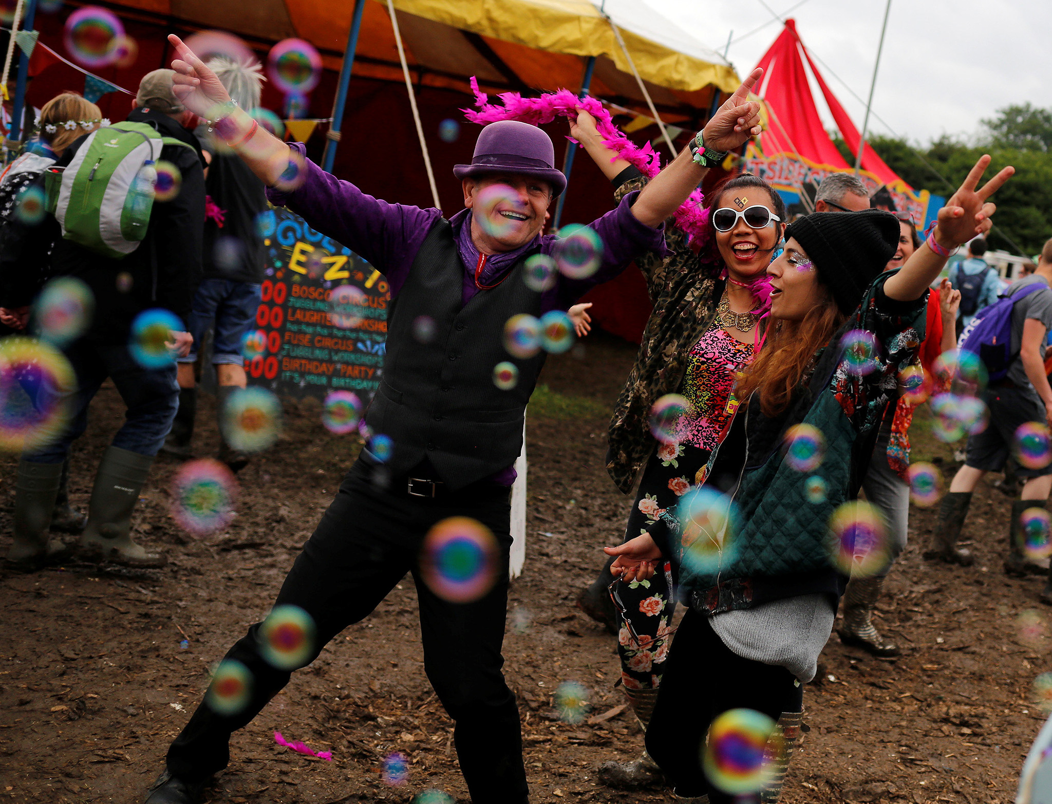 Revellers react while being photographed at Worthy Farm in Somerset during the Glastonbury Festival, Britain