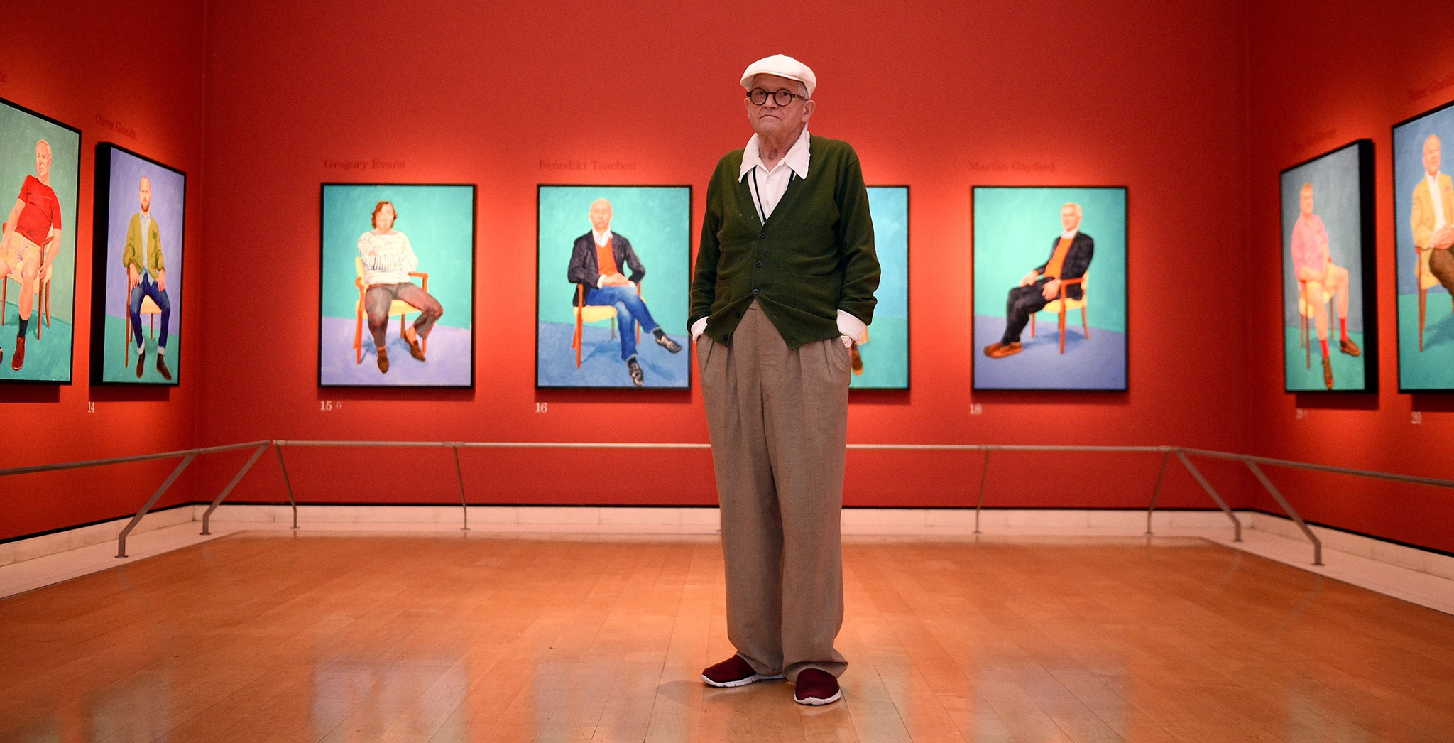 Artist David Hockney poses for photographs in the Sackler Wing at the Royal Academy of Arts, London, where an exhibition of his work entitled 'David Hockney RA: 82 Portraits and 1 Still-life', is on display