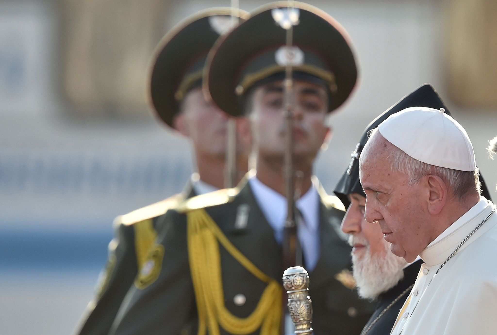 Pope Francis, flanked by Catholicos of All Armenians Karekin II, walks past honour guards to board a plane for Rome at Yerevan's Zvartnots Airport