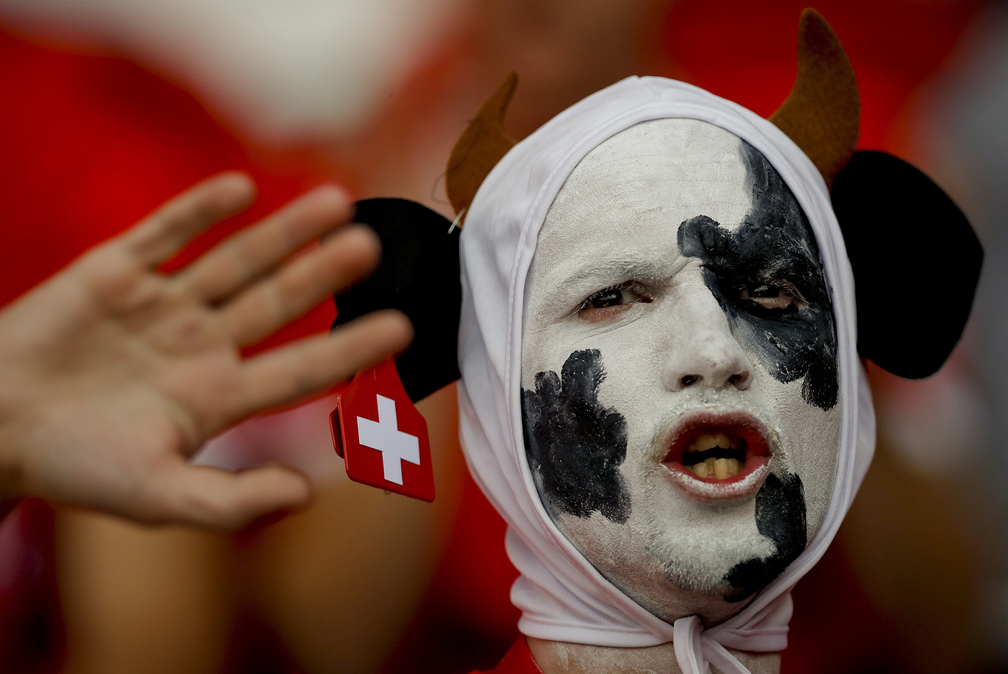 A Swiss fan waits for the start of the Euro 2016 Group A soccer match between Romania and Switzerland at the Parc des Princes stadium in Paris, France