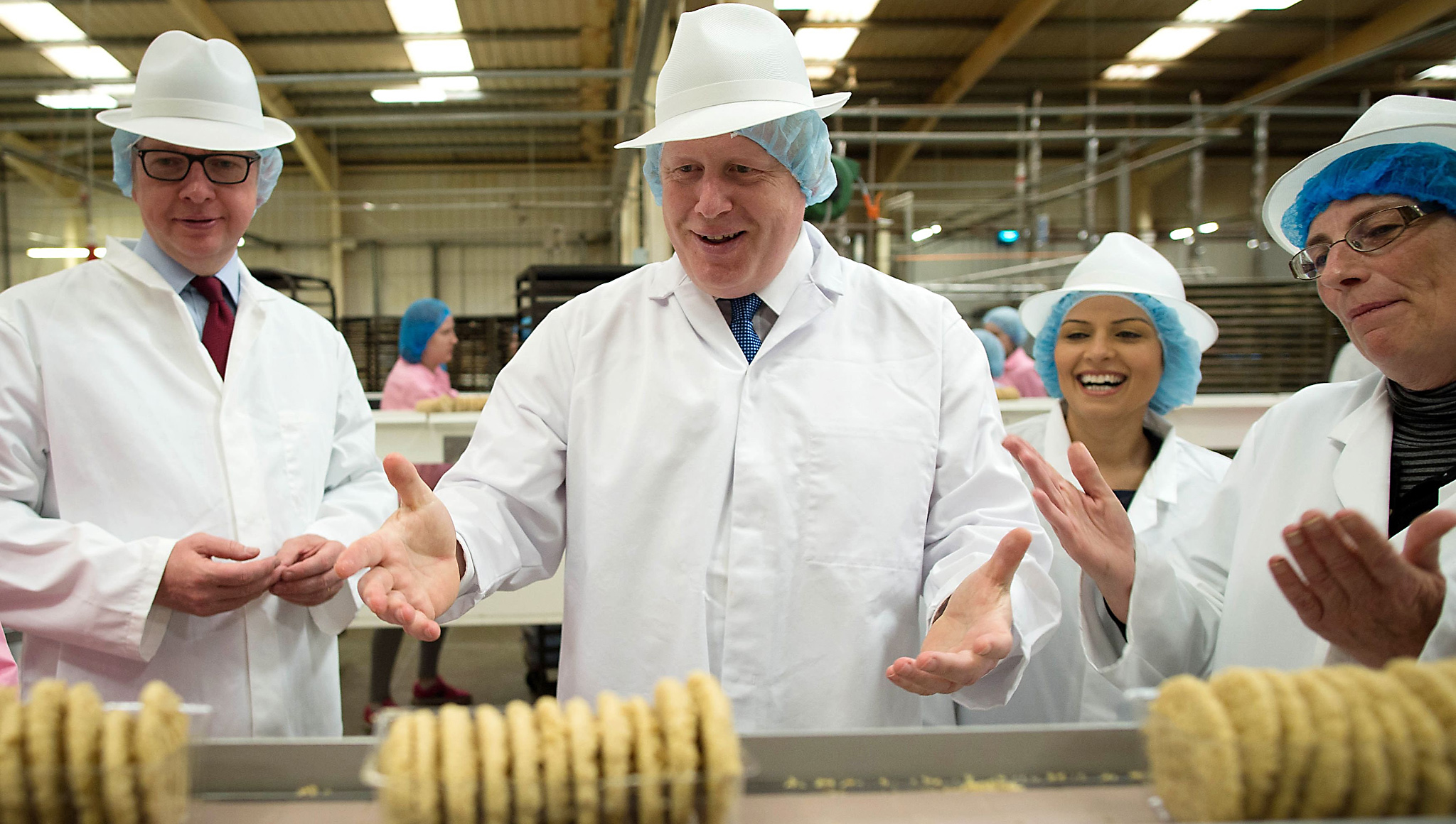 (from the left) Michael Gove, Boris Johnson and Priti Patel during a visit to Farmhouse Biscuits in Nelson, Lancashire, where they were campaigning on behalf of the Vote Leave EU referendum campaign. PRESS ASSOCIATION Photo. Picture date: Thursday June 2, 2016. See PA story POLITICS EU. Photo credit should read: Stefan Rousseau/PA Wire