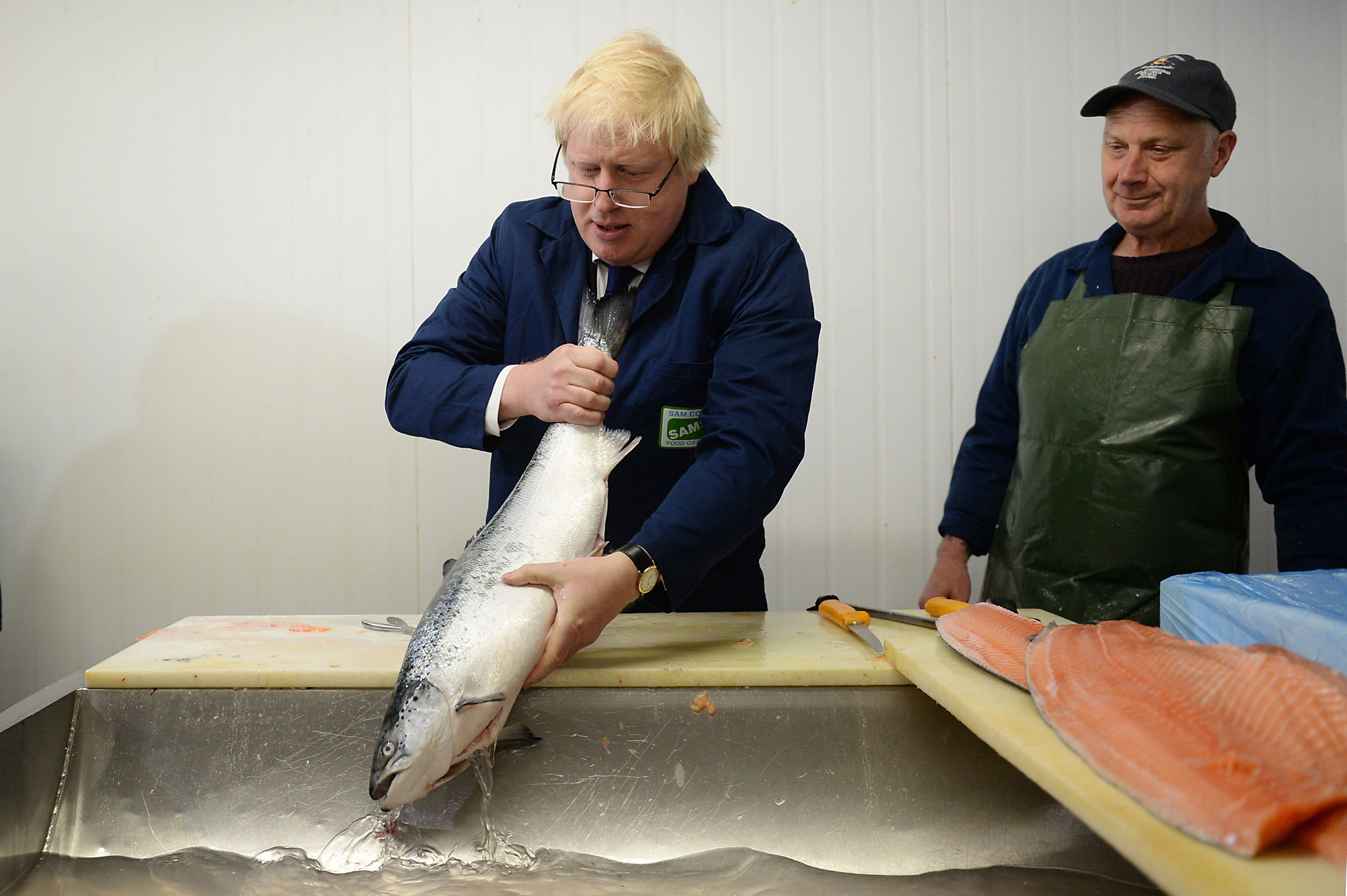 Boris Johnson MP chats with Basil Burgess (right) as he visits Sam Cole Foods fish processing factory in Lowestoft, Suffolk, where he was campaigning on behalf of the Vote Leave EU campaign. PRESS ASSOCIATION Photo. Picture date: Thursday June 16, 2016. See PA story POLITICS EU. Photo credit should read: Stefan Rousseau/PA Wire