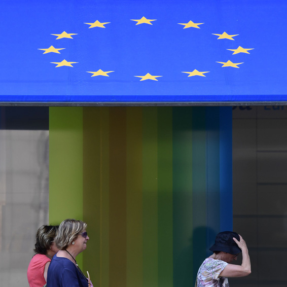 People pass by the office of the representation of the European Commission in Germany in Berlin on June 24, 2016.  Britain has voted to break out of the European Union, striking a thunderous blow against the bloc and spreading panic through world markets on June 24 as sterling collapsed to a 31-year low.  / AFP PHOTO / John MACDOUGALLJOHN MACDOUGALL/AFP/Getty Images