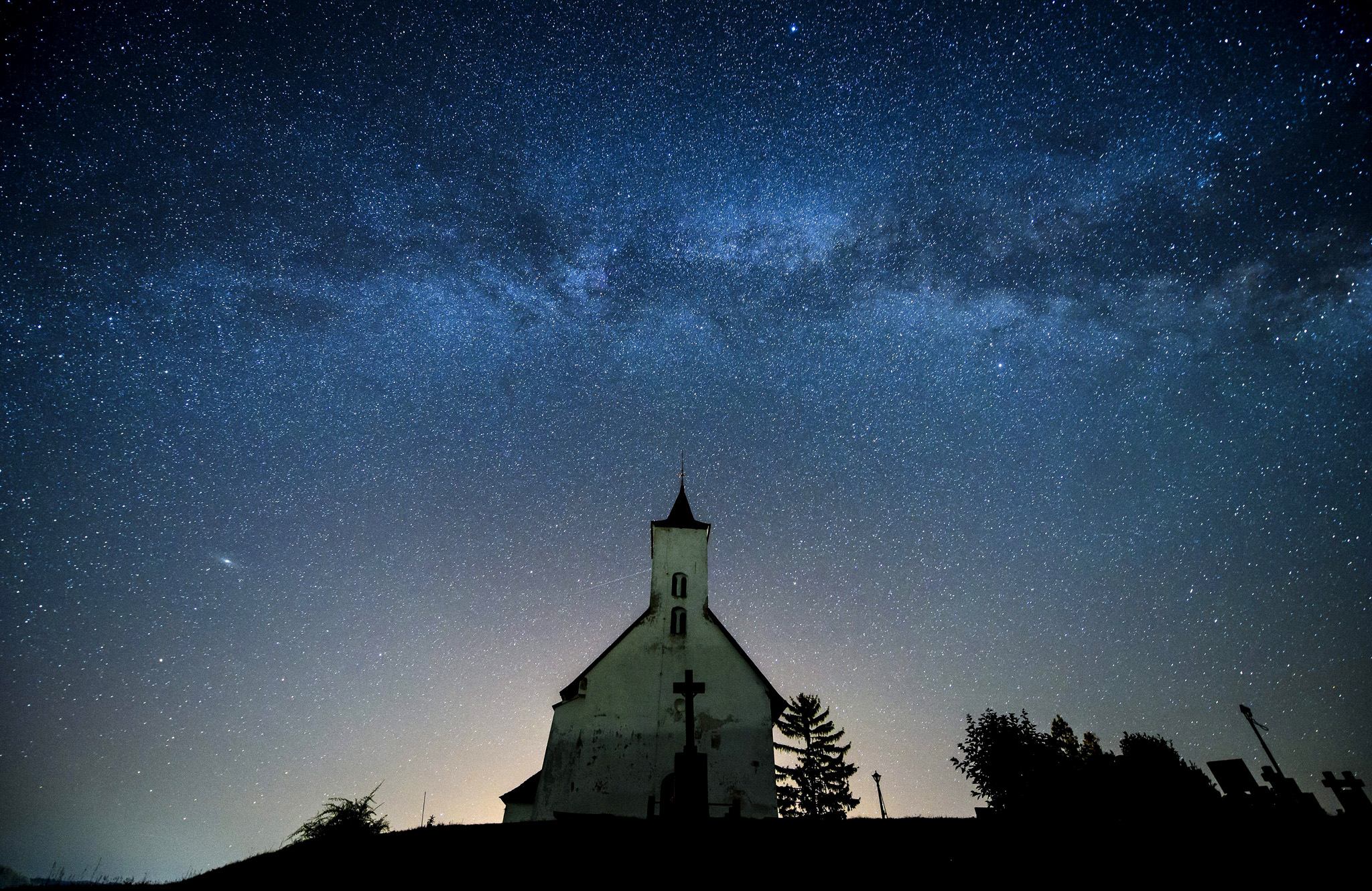 a church silhouetted below a belt of the Milky Way at the Hungarian-Slovakian border village Gemersky Jablonec, or Gomoralmagy in Hungarian, in southern Slovakia, 29 June 2016.  EPA/PETER KOMKA HUNGARY OUT