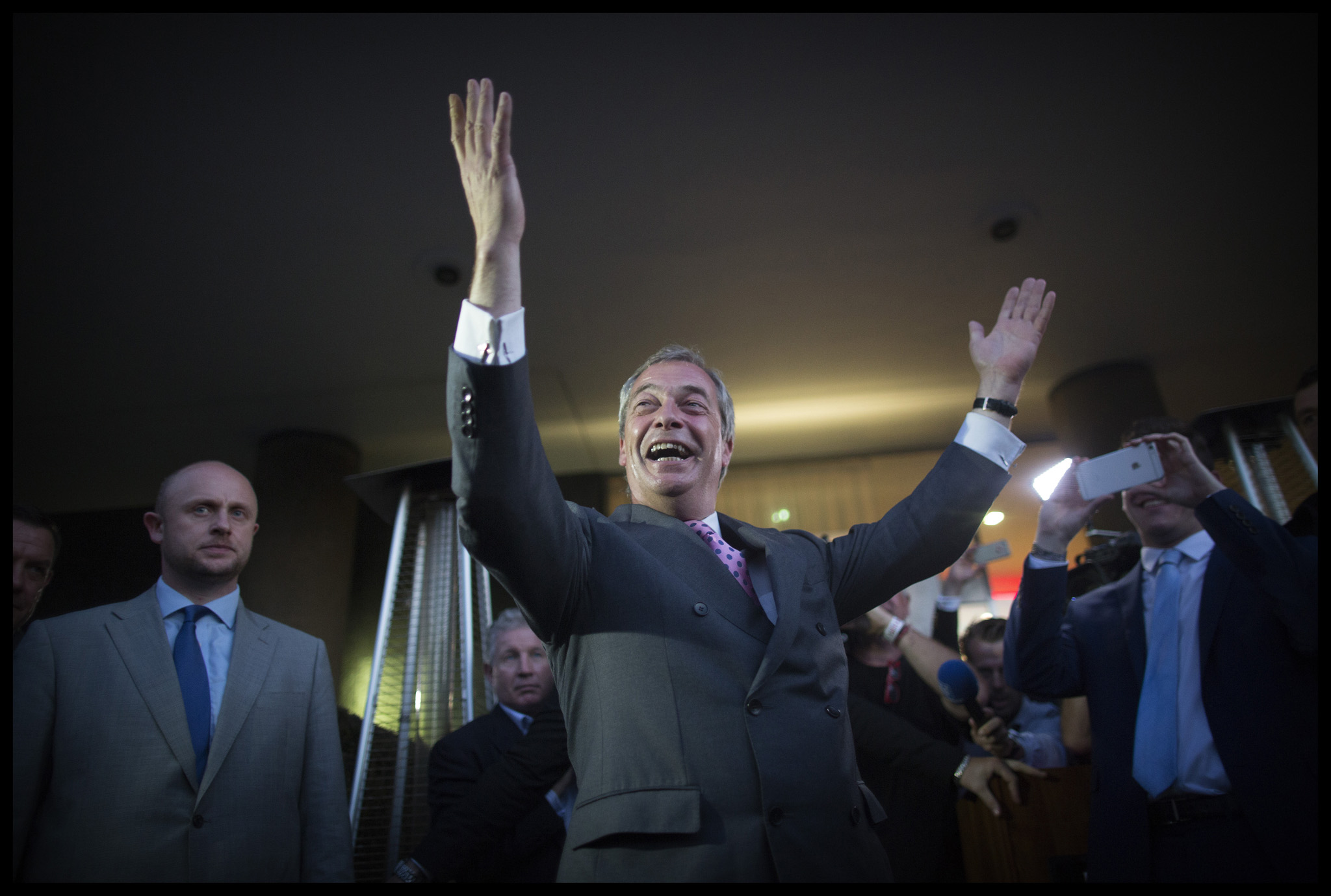 Leader of UKIP, Nigel Farage, celebrates victory in the EU Referendum at the leave.eu party in Milbank, London.