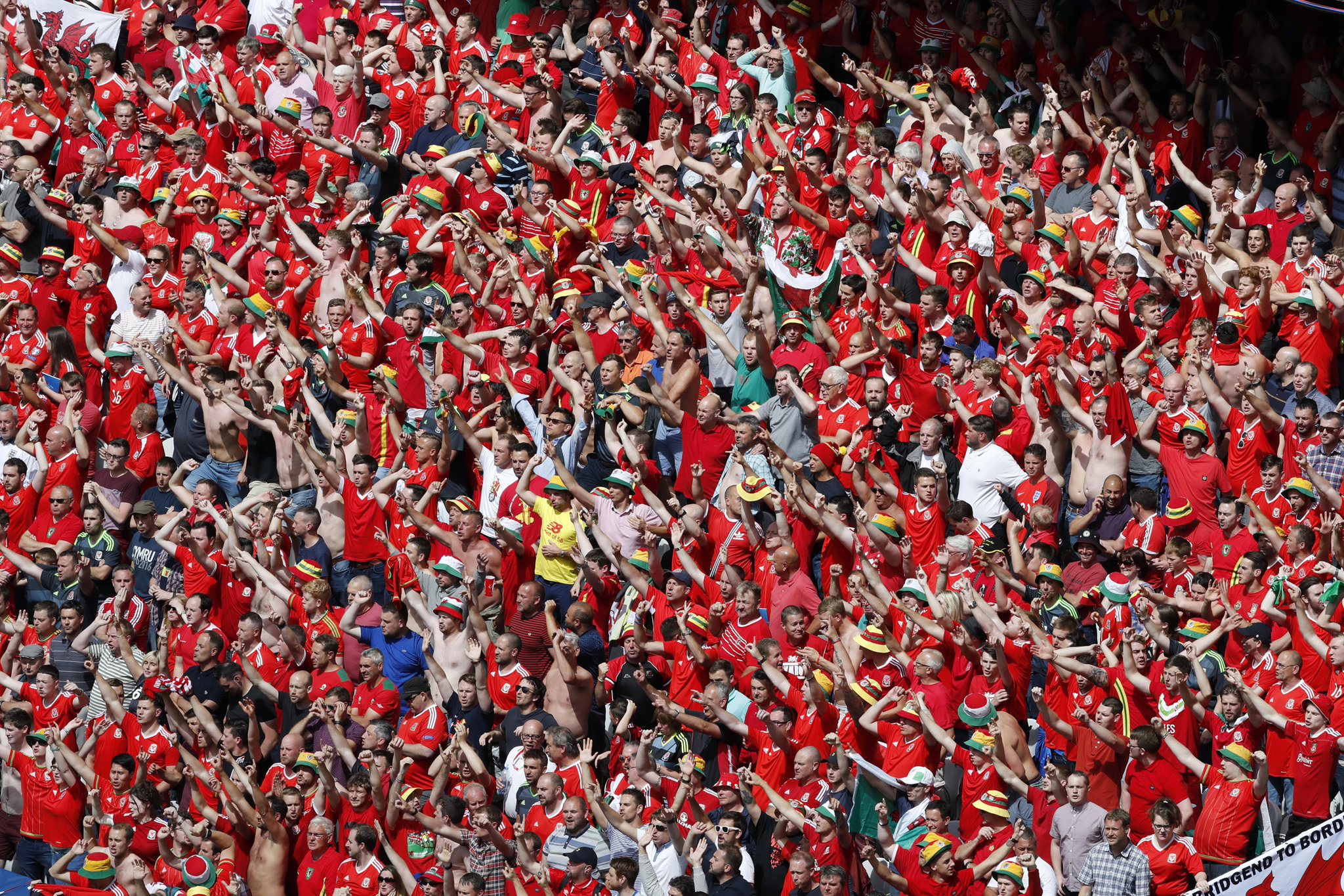 Wales supporter cheer during the Euro 2016 Group B soccer match between England and Wales at the Bollaert stadium in Lens, France, Thursday, June 16, 2016. (AP Photo/Michel Spingler)