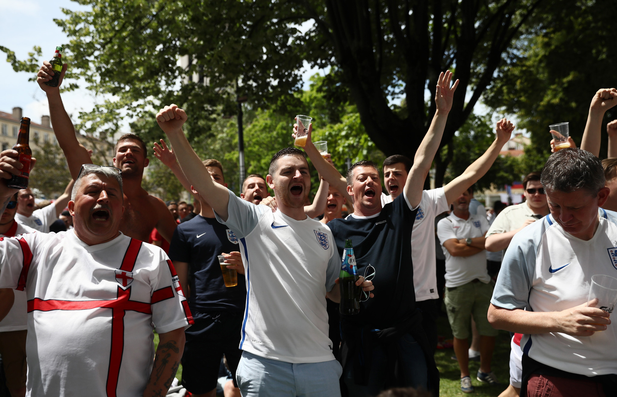 SAINT-ETIENNE, FRANCE - JUNE 20: England fans sing as they gather ahead of today's England v Slovakia UEFA Euros 2016 Group B match, on June 20, 2016 in Saint-Etienne, France. Following a draw against Russia in Marseille and a win against Wales in Lille, England fans have travelled to the central French city for the final group game against Slovakia.  (Photo by Carl Court/Getty Images)