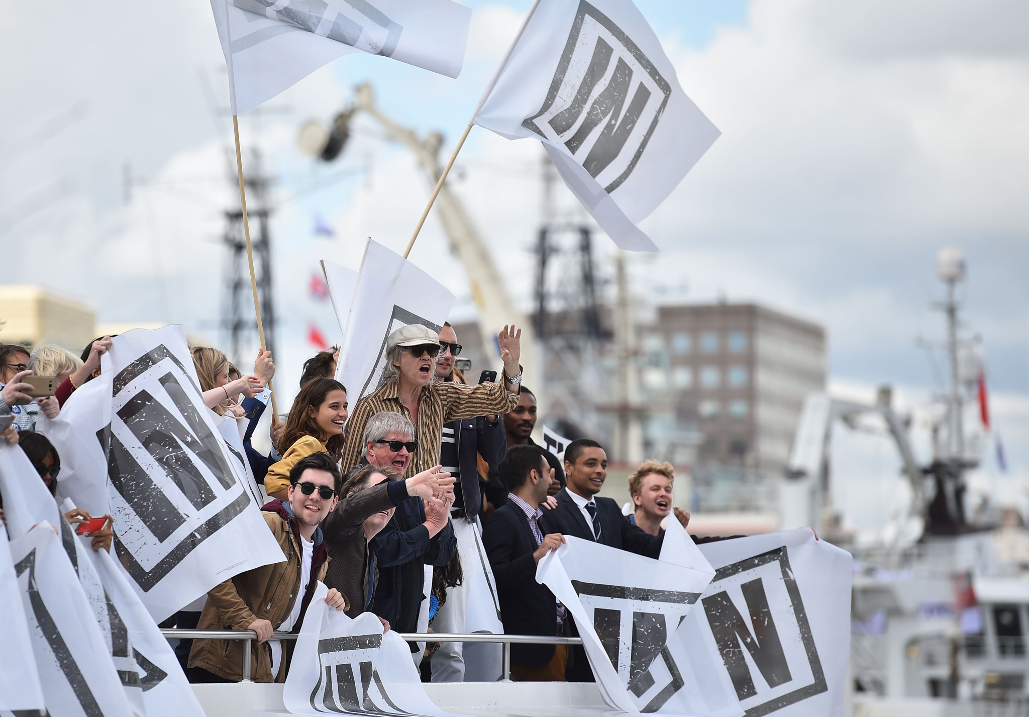 A boat carrying supporters for the Remain in the EU campaign including Sir Bob Geldoff (C) shout and wave at Brexit fishing boats as they sail up the river Thames in central London on June 15, 2016. A Brexit flotilla of fishing boats sailed up the River Thames into London today with foghorns sounding, in a protest against EU fishing quotas by the campaign for Britain to leave the European Union. / AFP PHOTO / BEN STANSALLBEN STANSALL/AFP/Getty Images