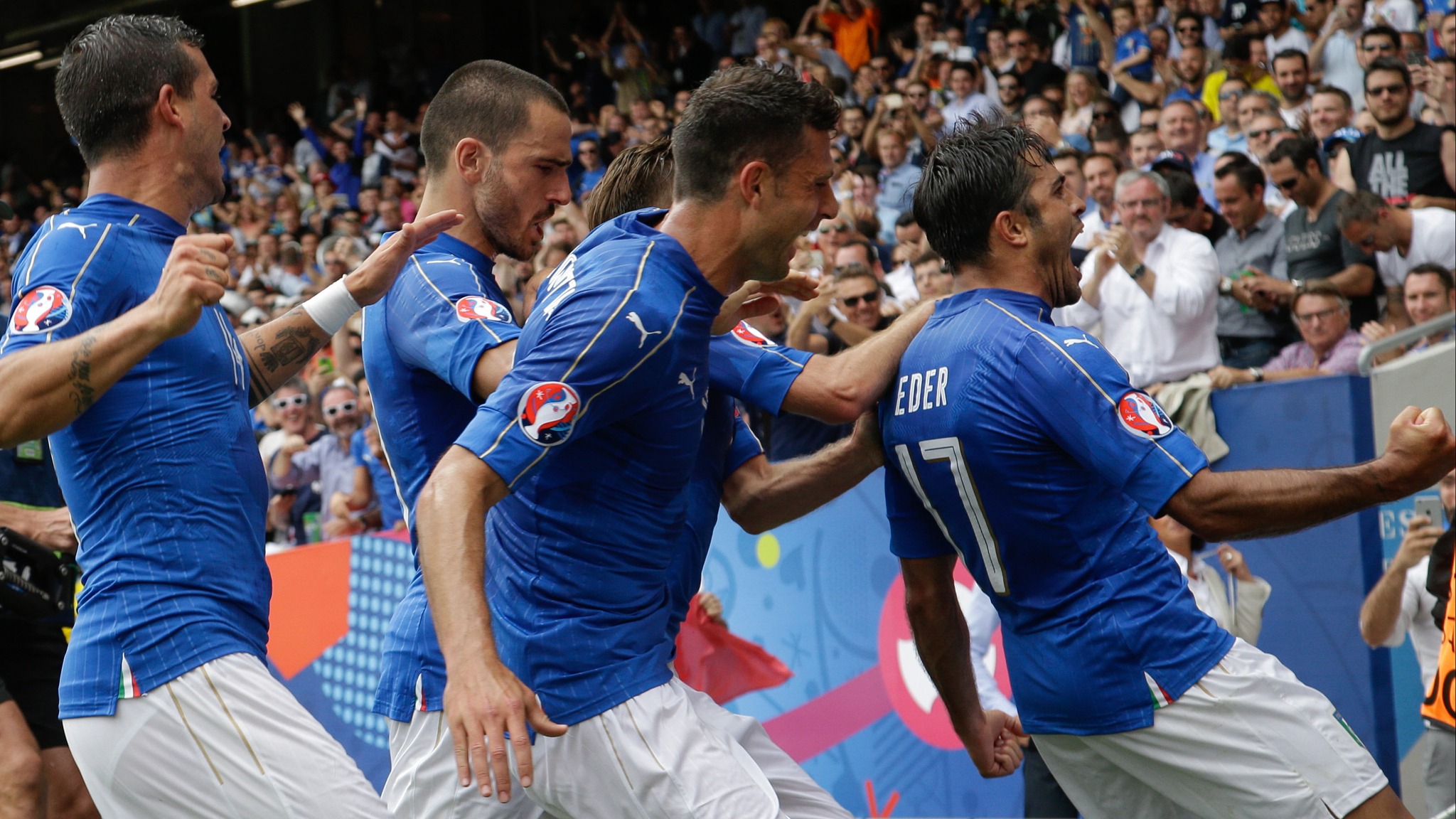 Italy's Eder, right, celebrates after scoring the opening goal during the Euro 2016 Group E soccer match between Italy and Sweden at the Stadium municipal in Toulouse, France, Friday, June 17, 2016. (AP Photo/Andrew Medichini)