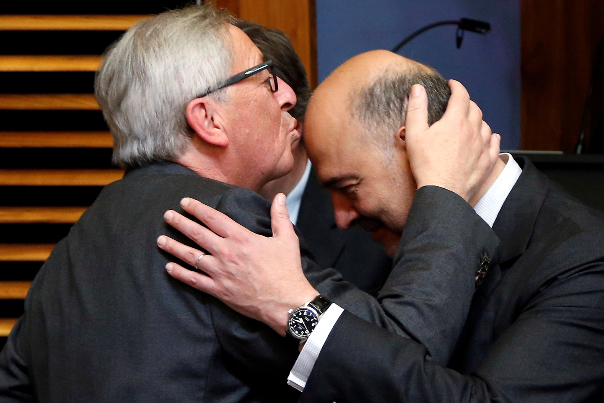 European Commission President Jean-Claude Juncker kisses European Economic and Financial Affairs Commissioner Pierre Moscoviciduring a meeting of the EU's executive body in Brussels, Belgium, June 27, 2016.    REUTERS/Francois Lenoir