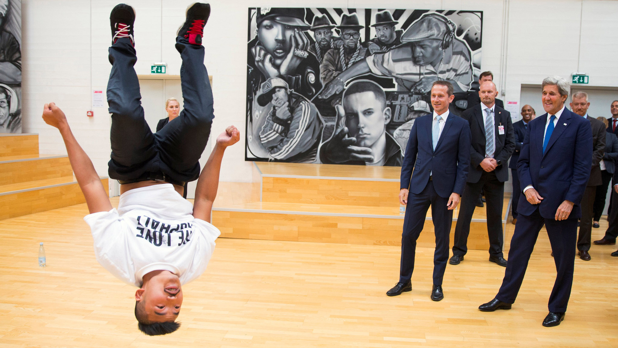 U.S. Secretary of State John Kerry (R) and Danish Foreign Minister Kristian Jensen look on as a breakdancer performs during a tour of GAME, an organization that promotes youth sports, in Copenhagen, Denmark June 17, 2016. REUTERS/Evan Vucci/Pool