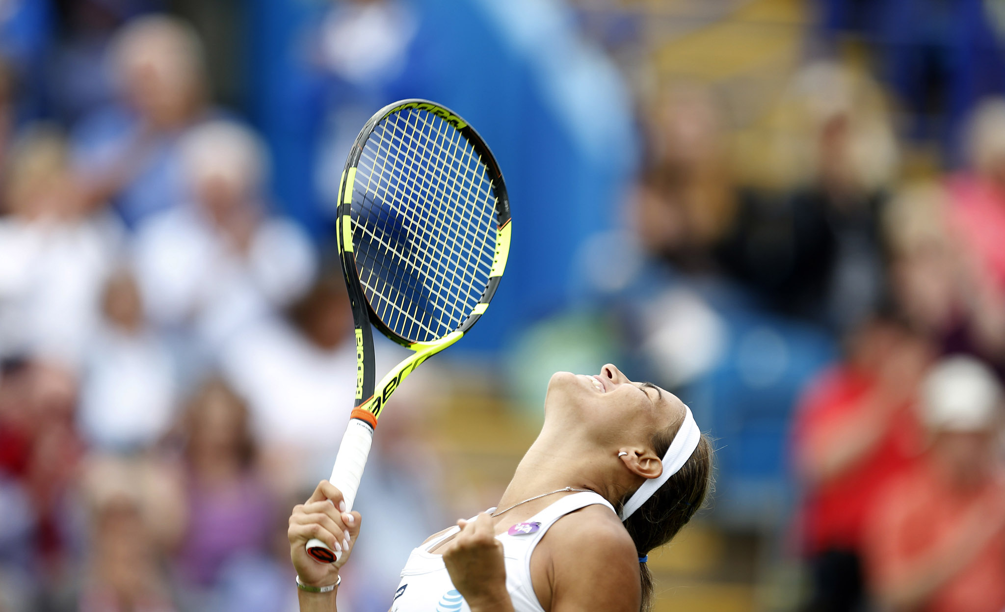 Puerto Rico's Monica Puig celebrates winning against Denmark's Caroline Wozniacki (not in picture) during day three of the 2016 AEGON International at Devonshire Park, Eastbourne. PRESS ASSOCIATION Photo. Picture date: Wednesday June 22, 2016. See PA story TENNIS Eastbourne. Photo credit should read: Steve Paston/PA Wire. RESTRICTIONS: Editorial use only, No commercial use without prior permission, please contact PA Images for further information: Tel: +44 (0) 115 8447447.