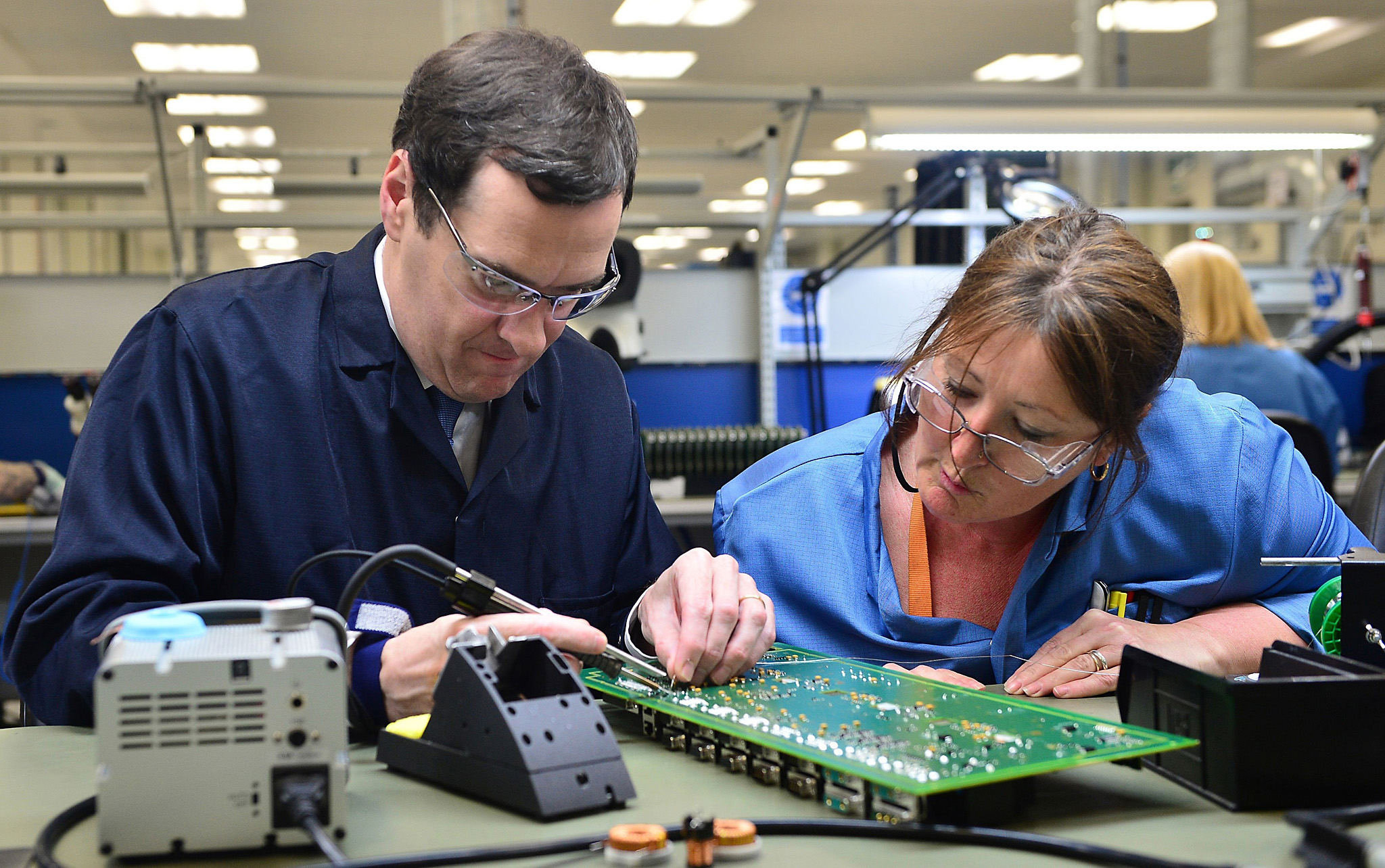 Chancellor George Osborne solders a printed circuit board with Karen Greenfield during an EU related visit to Renishaw Plc in Woodchester near Stroud, Gloucestershire. PRESS ASSOCIATION Photo. Picture date: Tuesday June 14, 2016. See PA story POLITICS EU. Photo credit should read: Ben Birchall/PA Wire