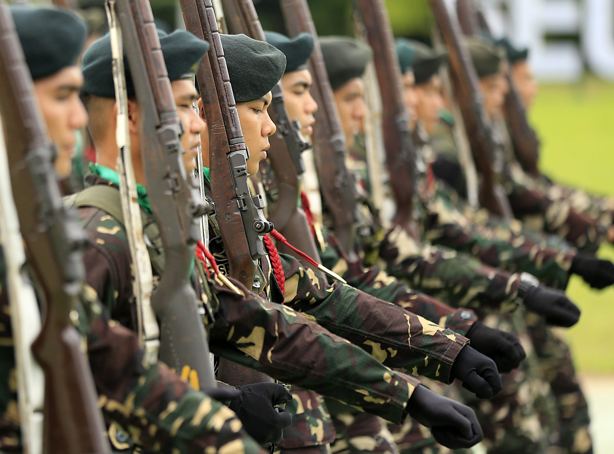 epa05387047 Filipino army soldiers parade during Defense Secretary Voltaire Gazmin's (unseen) visit to a military camp in Taguig city, south of Manila, Philippines, 24 June 2016. According to defense secretary Voltaire Gazmin, the armed forces of the Philippines continue pursuing the Abu Sayyaf in southern Philippines as the terrorist group abducted anew seven Indonesian sailors. The Islamist Abu Sayyaf group released Filipino hostage Marites Flor, western Mindanao command spokesman Filemon Tan said.  EPA/EUGENIO LORETO