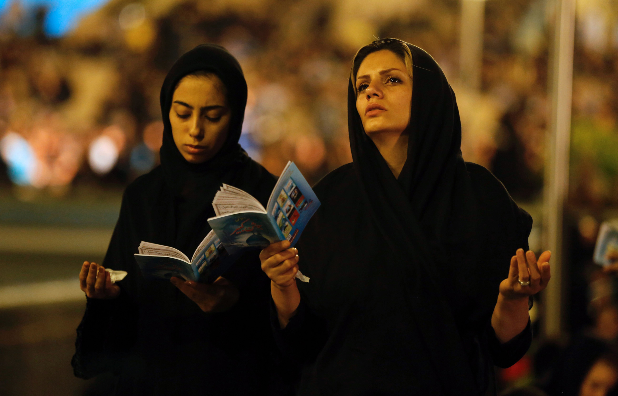 Iranian Shiite Muslim women pray at the Imam Khomeini grand mosque in the capital Tehran in the early hours of July 27, 2016 in commemoration of the death of the seventh century Imam Ali bin Abi-Taleb
