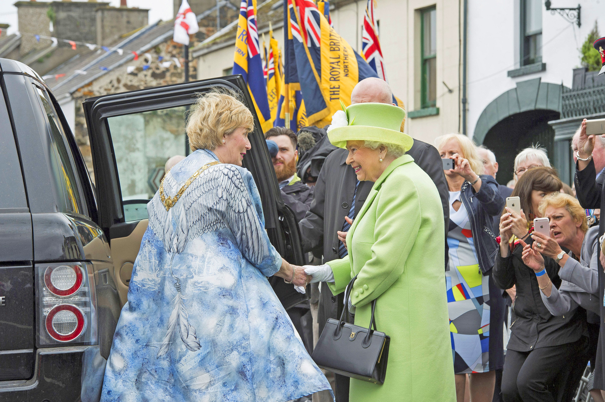 Queen Elizabeth II and Prince Philip, Duke Of Edinburgh (unseen) attend the unveiling of the Robert Quigg VC memorial statue in Bushmills village, Northern Ireland, June 28, 2016