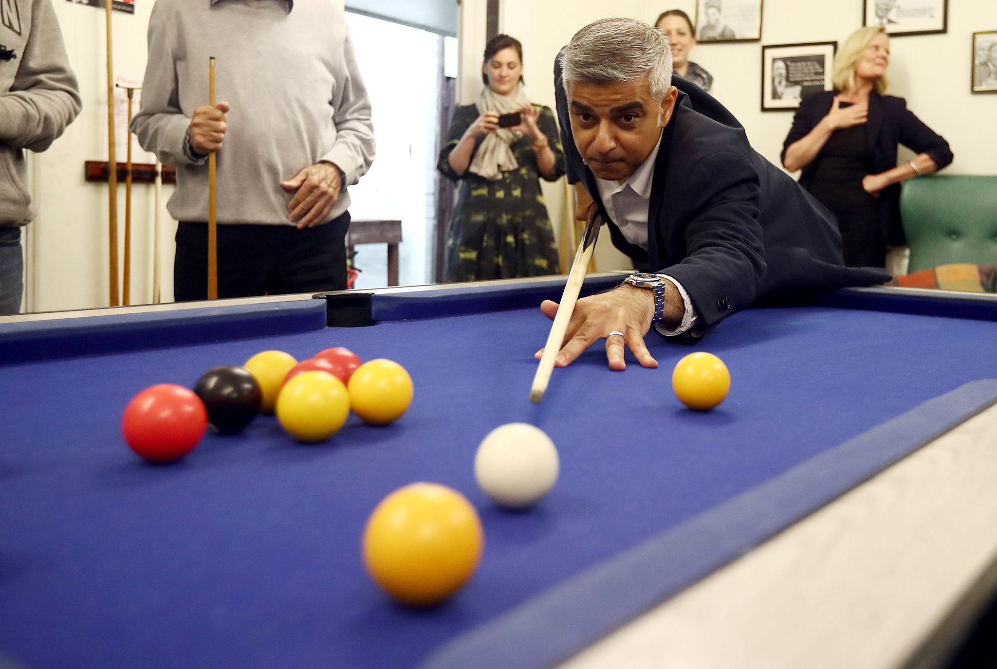 London mayor Sadiq Khan plays pool during a visit to Age UK Lewisham and Southwark pensioner day centre on June 1, 2016 in London, England. Mr Khan used the visit to launch Volunteers' Week and set out his plans to make social integration a core priority of his tenure.  (Photo by Carl Court/Getty Images) ***BEST