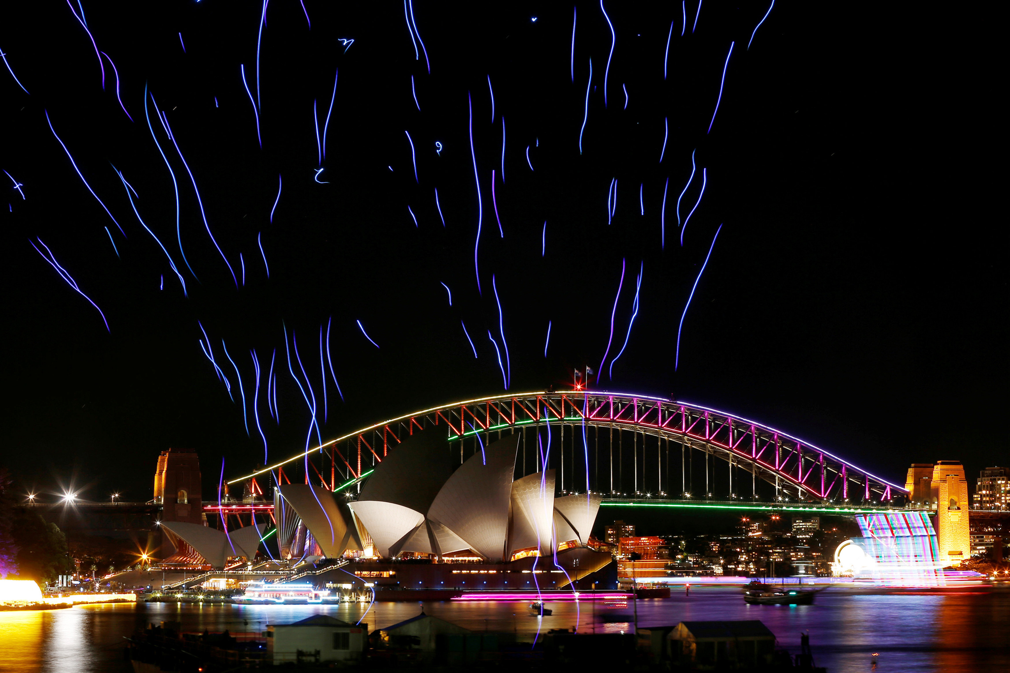An aerial performance featuring 100 illuminated drones lift off from a barge on Sydney Harbour in front the Sydney Harbour Bridge and Opera House during the Vivid Sydney light festival in Sydney, Australia, June 9, 2016. REUTERS/Jason Reed TPX IMAGES OF THE DAY