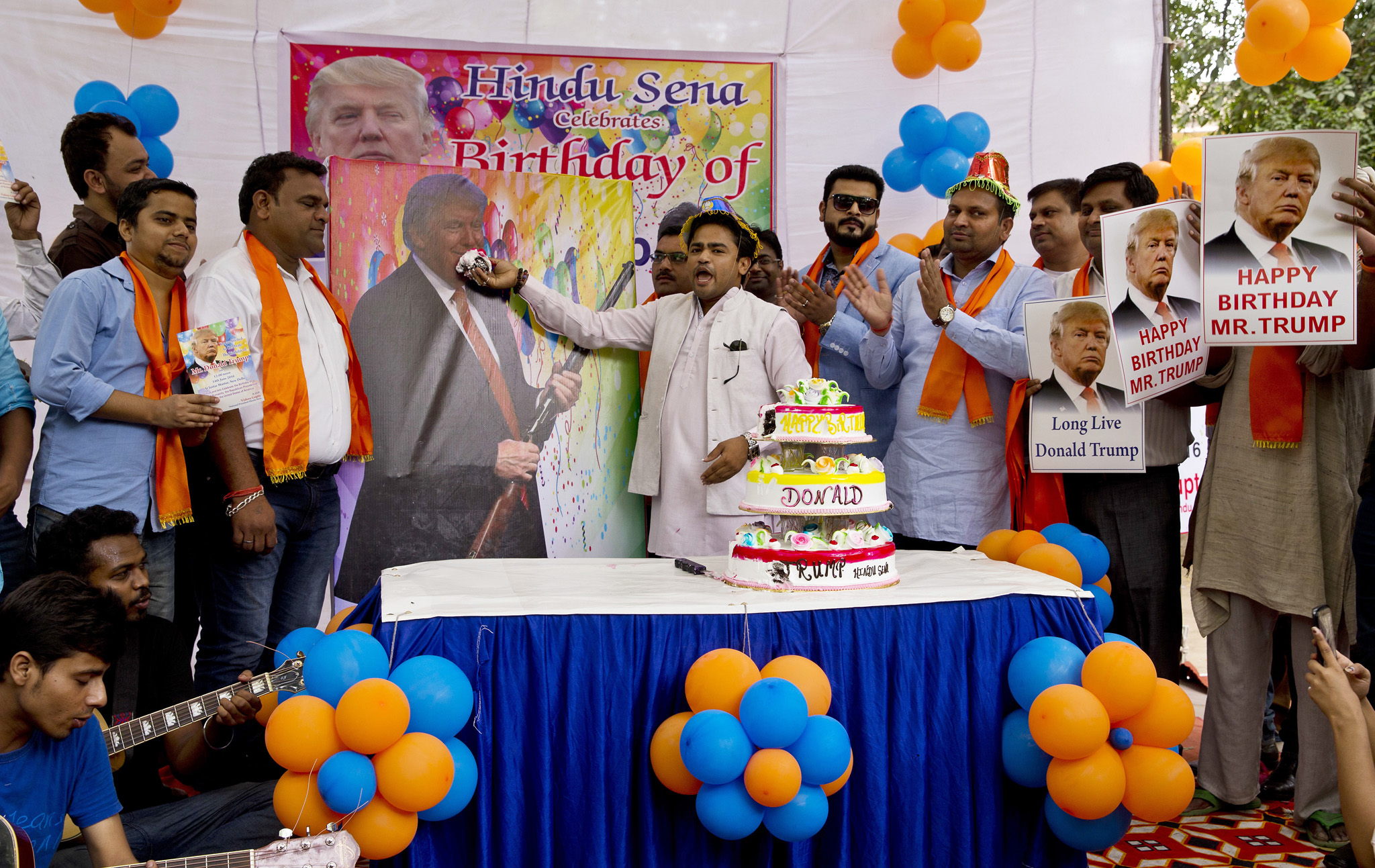 Members of Hindu nationalist party 'Hindu Sena' or Hindu Army, celebrate the birthday of U.S. presidential candidate Donald Trump in New Delhi, India, Tuesday, June 14, 2016. The political group had earlier performed Hindu rituals to ensure Trump's presidential win and to solve the growing problems of Islamic terrorism. (AP Photo/Saurabh Das)