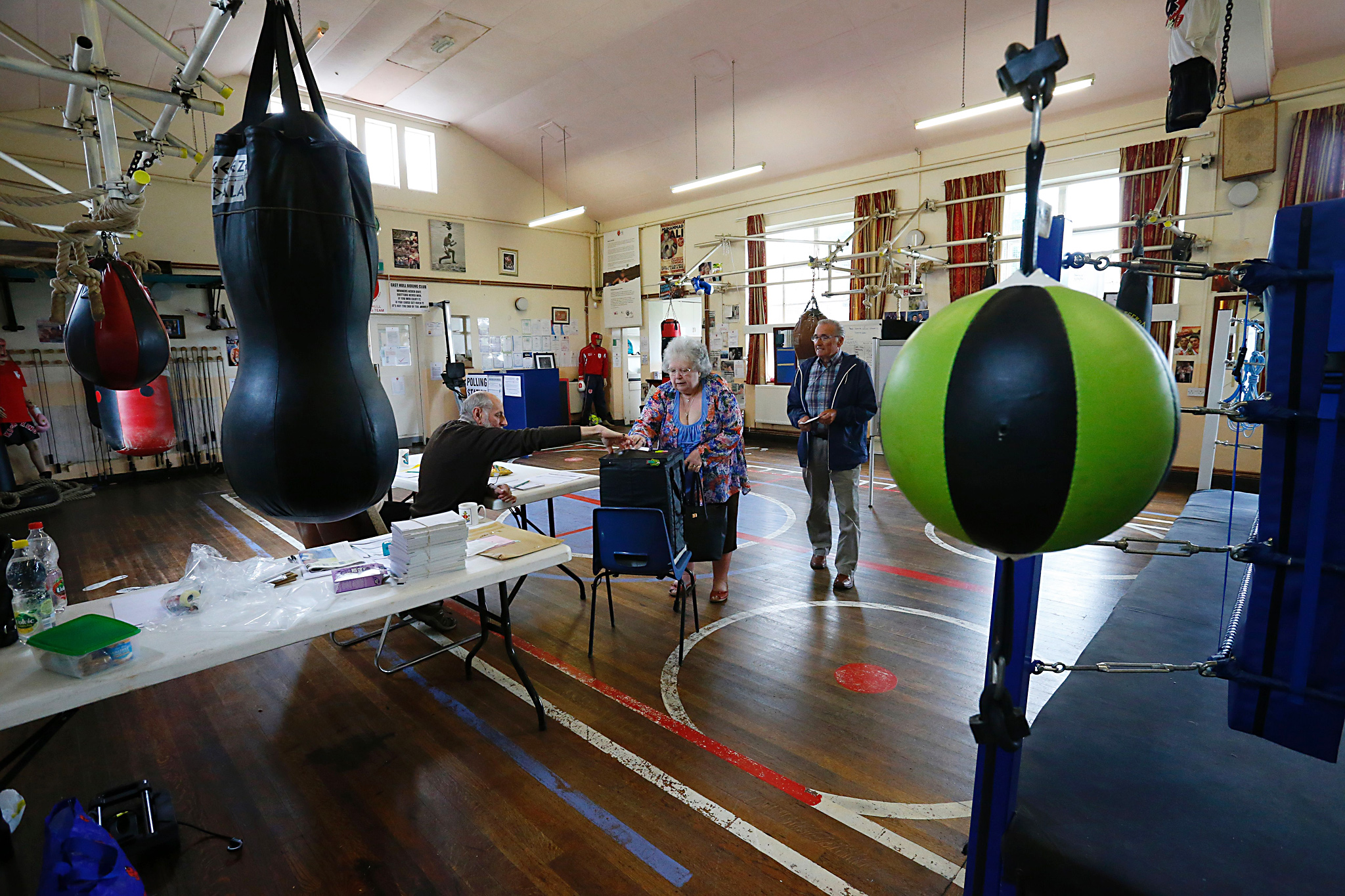 Local residents cast their votes on the EU referendum at a polling staton at the East Hull Boxing Club in Kingston-Upon-Hull, northern England on June 23, 2016. Millions of Britons began voting today in a bitterly-fought, knife-edge referendum that could tear up the island nation's EU membership and spark the greatest emergency of the bloc's 60-year history. / AFP / Lindsey Parnaby        (Photo credit should read LINDSEY PARNABY/AFP/Getty Images)