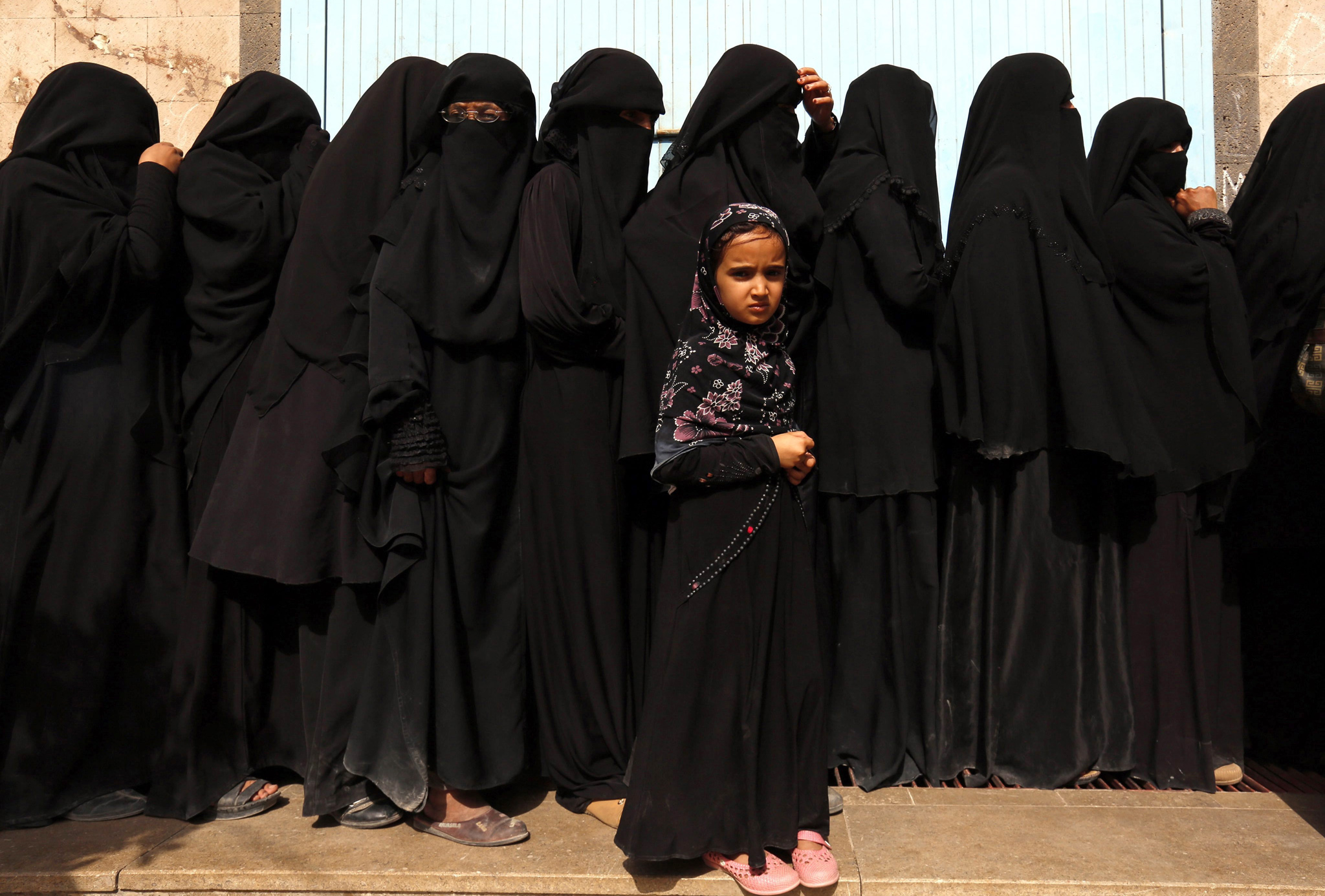 epa05341566 Conflict-affected women line up to receive their families' food rations provided by a local relief group, in Sana'a, Yemen, 02 June 2016. According to reports, the year-long conflict has worsened Yemen's already poor food security situation, leaving 21 million people of the country's 24 million-population facing severely shortages of food and vital supplies 2.5 million others forcibly displaced.  EPA/YAHYA ARHAB