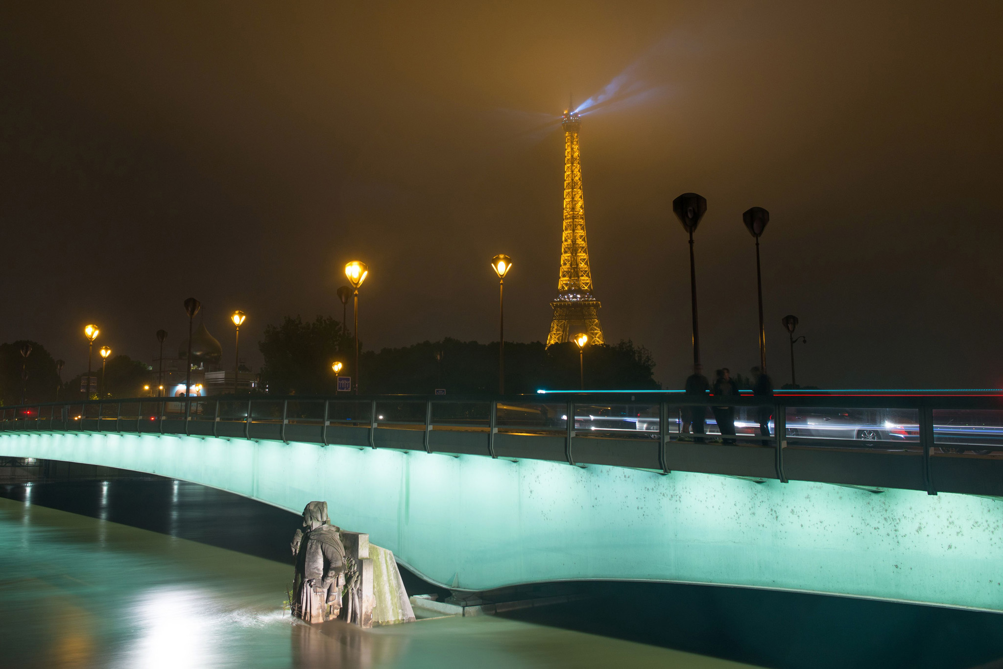 Water rising near the statue of the Zouave and the Eiffel Tower at the Alma bridge in Paris.