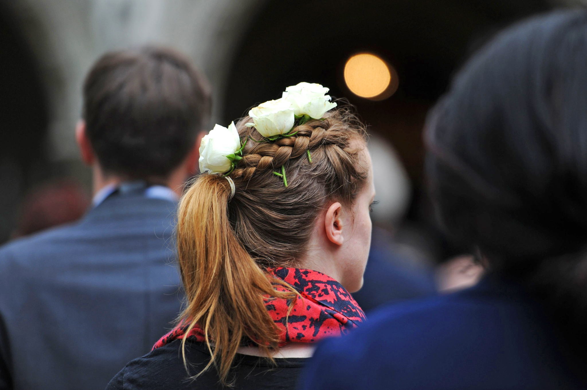 An MP wears white roses in her hair as she arrives with other MPs at St Margaret's Church, London, for a service of prayer and remembrance to commemorate Jo Cox MP. PRESS ASSOCIATION Photo. Picture date: Monday June 20, 2016. Members of the UK Parliament attended the service to commemorate Labour MP Jo Cox. Addresses were given by the Speaker's Chaplain, the Reverend Rose Hudson-Wilkin with readings by the Speaker, the Honourable John Bercow and Glenys Kinnock, Baroness Kinnock of Holyhead. See PA story POLITICS MP Service. Photo credit should read: Nick Ansell/PA Wire